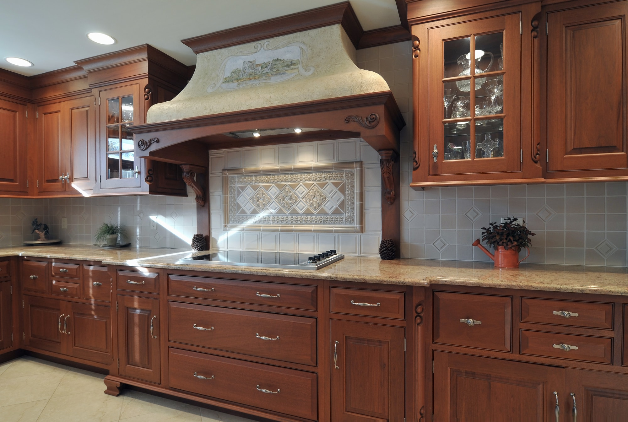 Traditional style kitchen with custom tile backsplash