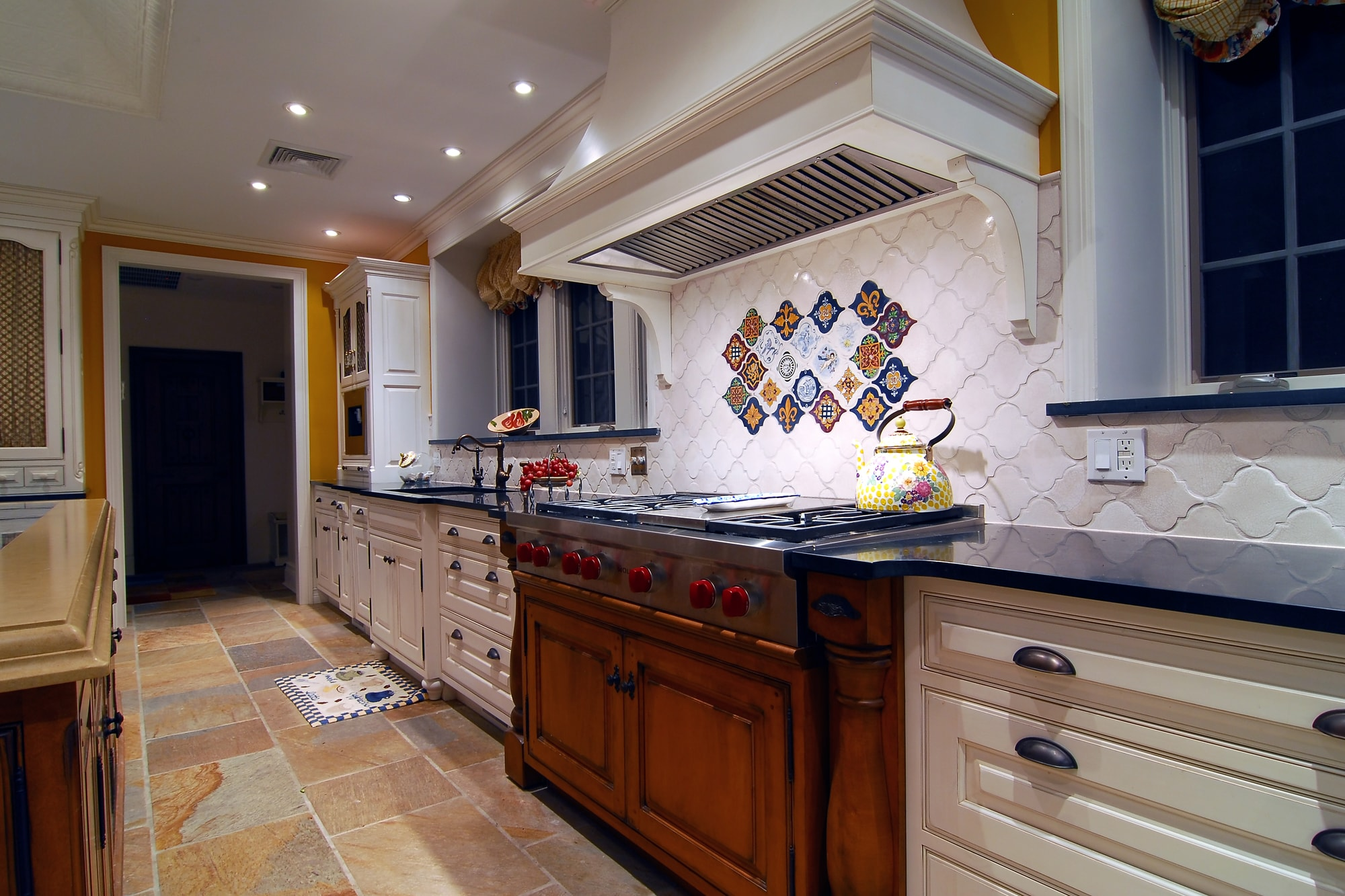 Traditional style kitchen with custom built range hood