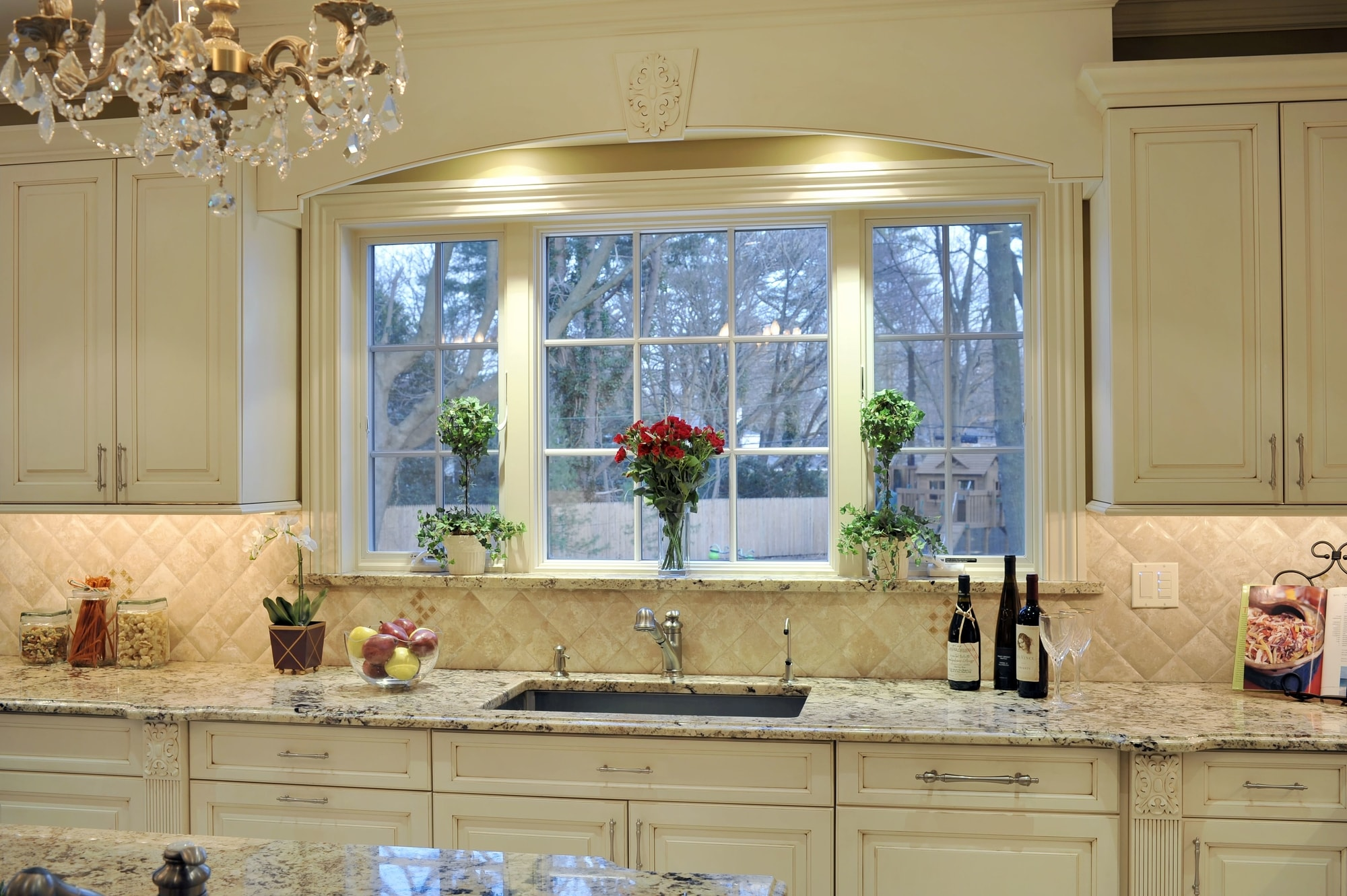 Traditional style kitchen with white bay window