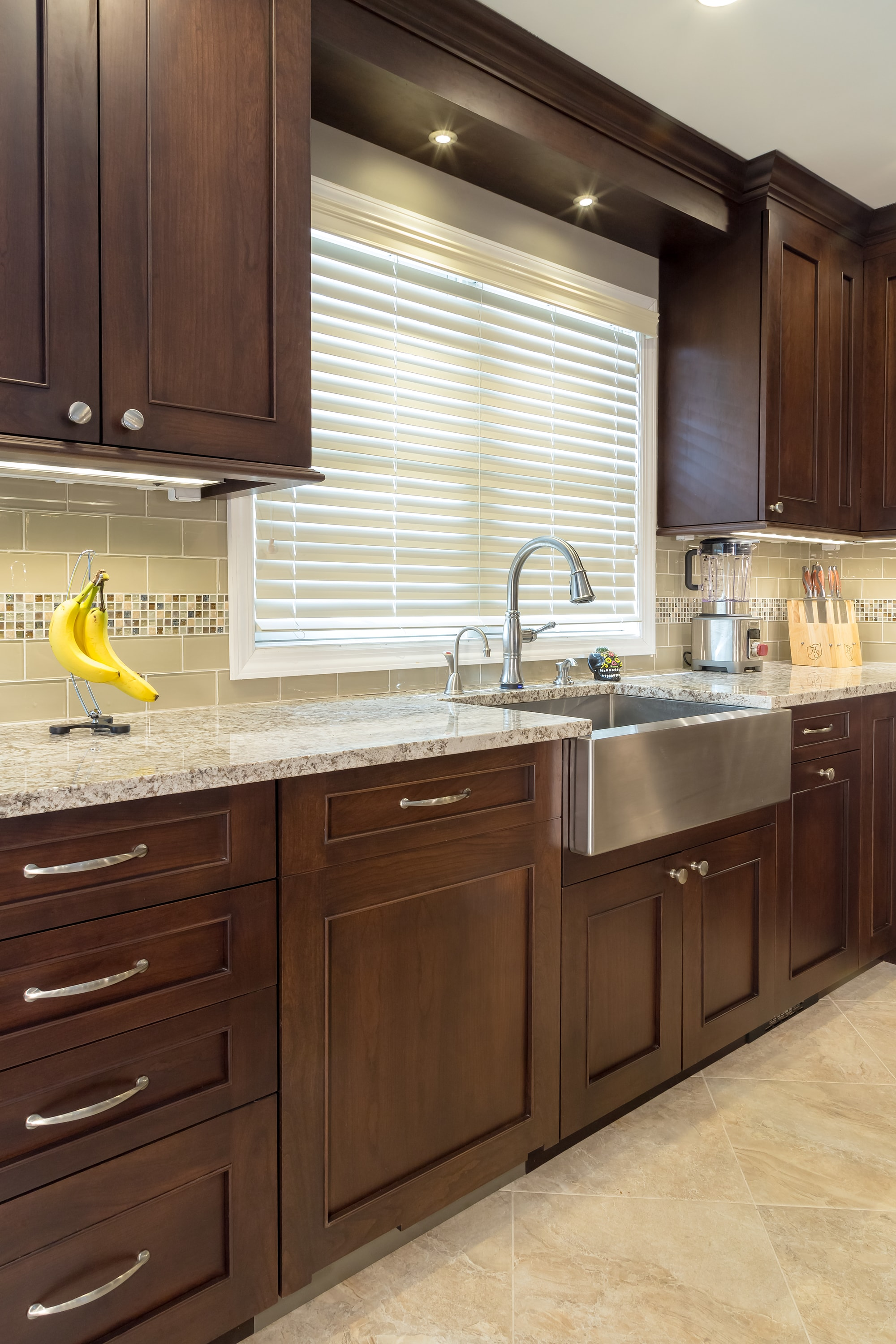 Traditional style kitchen with stainless steel faucet