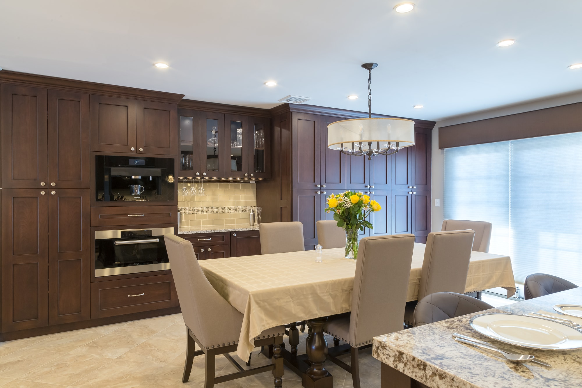 Traditional style kitchen with long dining table