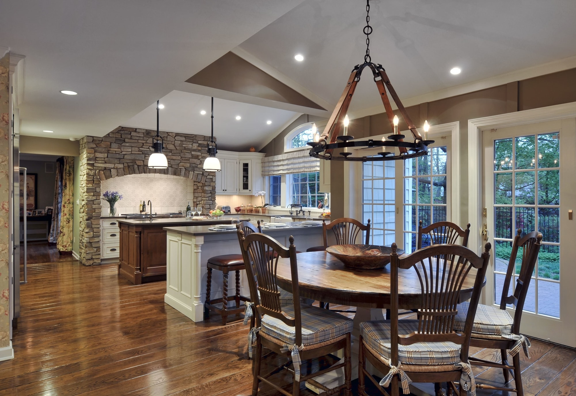 Traditional style kitchen with round breakfast table