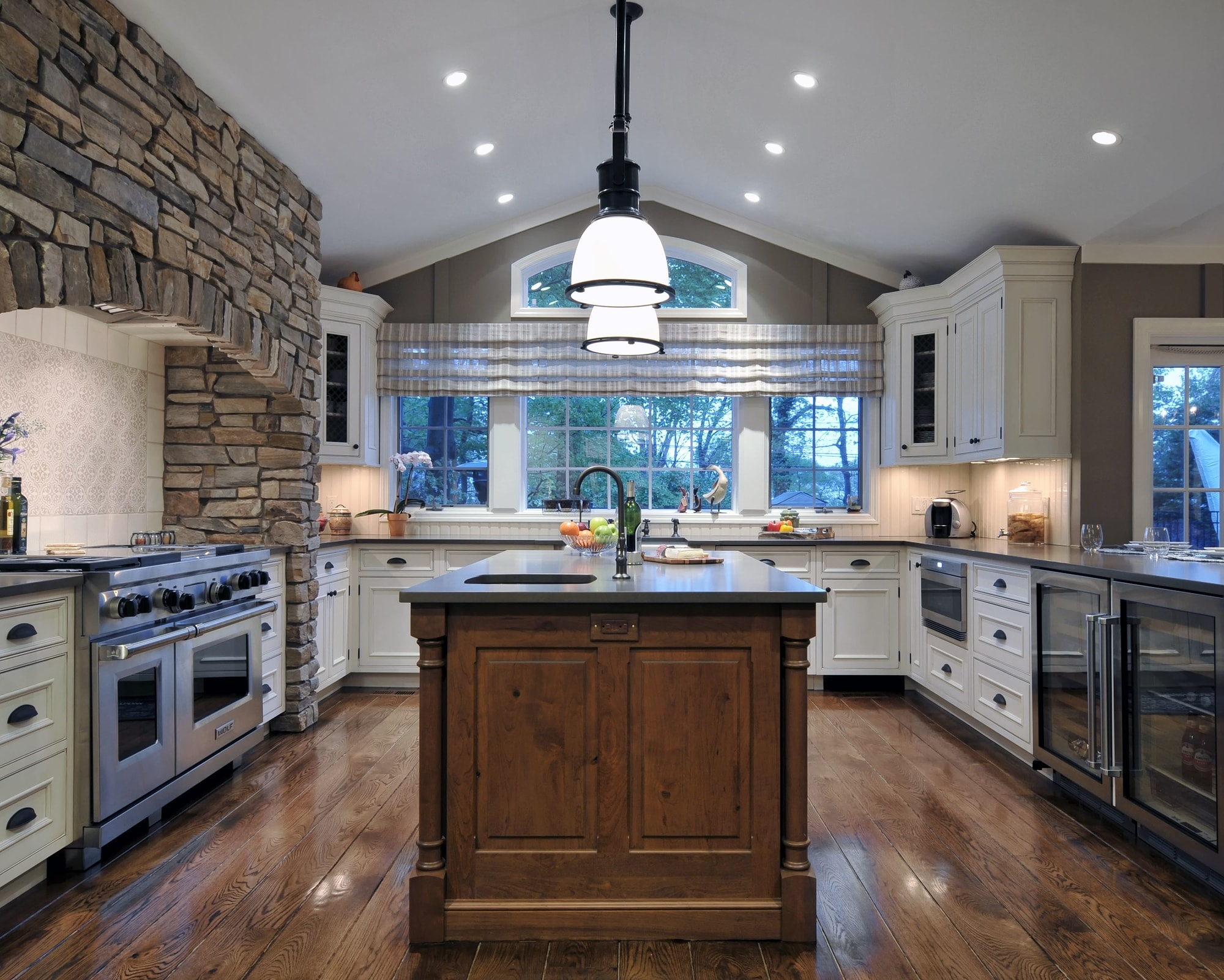 Traditional style kitchen with brick range hood