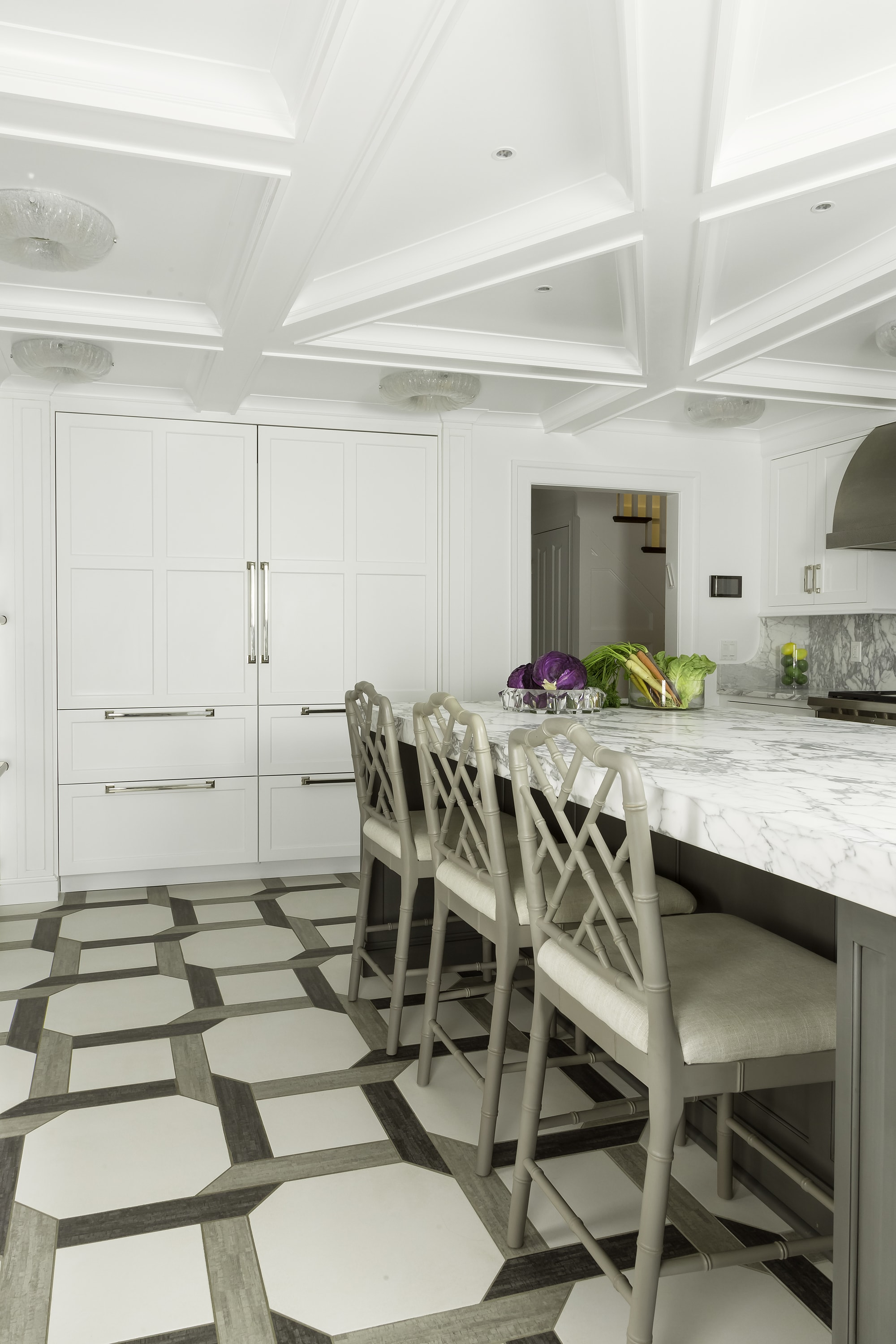 Transitional style kitchen with three color matched chairs