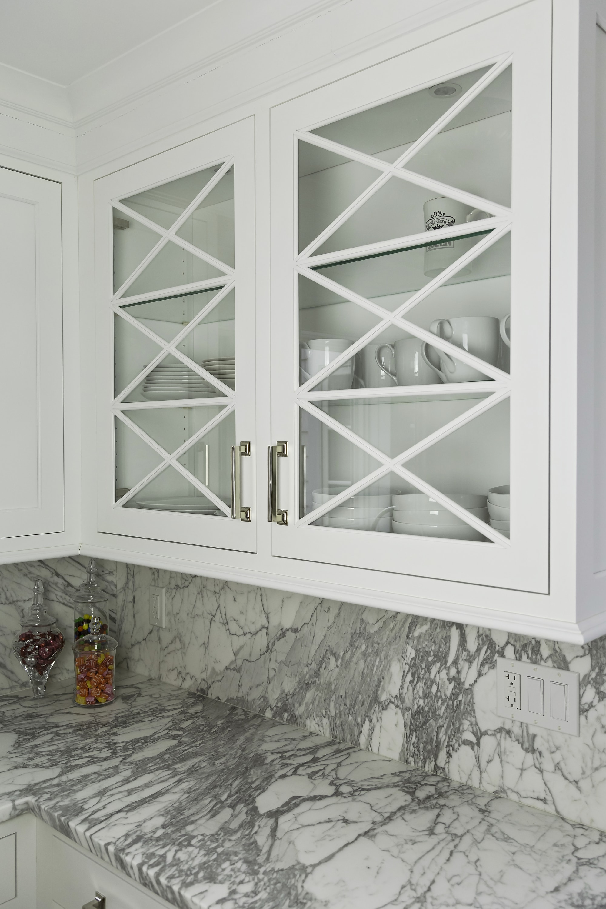 Transitional style kitchen with with glass door storage cabinet