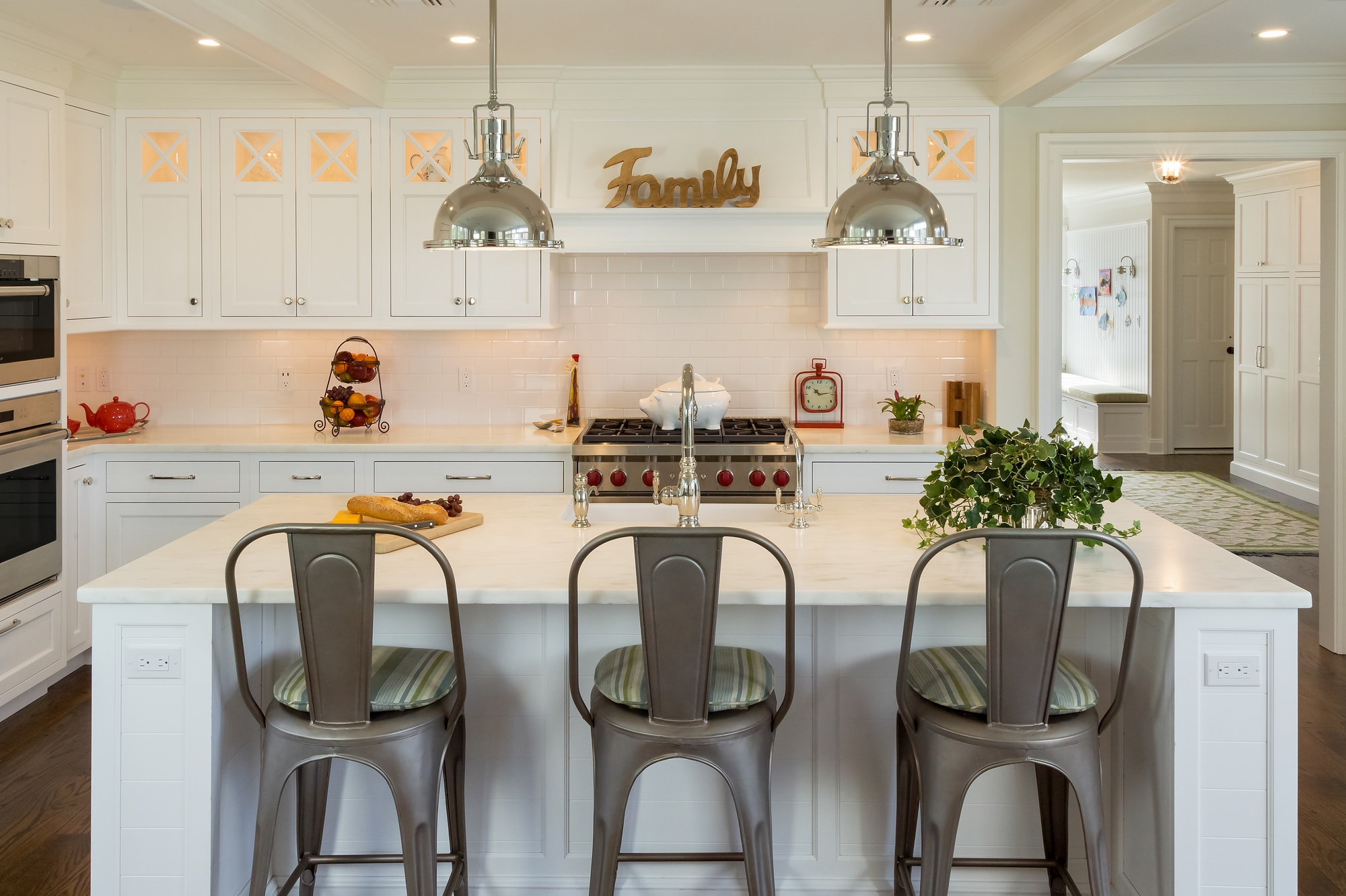 Transitional style kitchen with three pantry chairs at the kitchen island