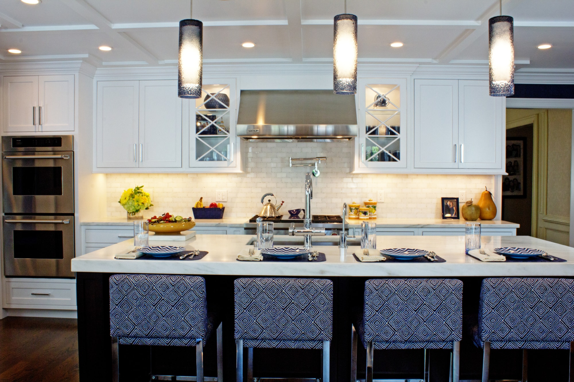 Transitional style kitchen with elegant pendant light fixtures
