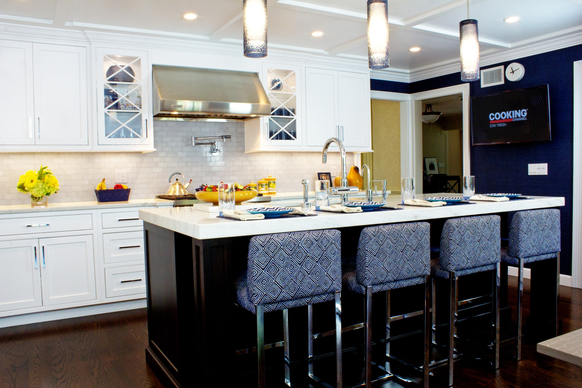 Transitional style kitchen with long center island