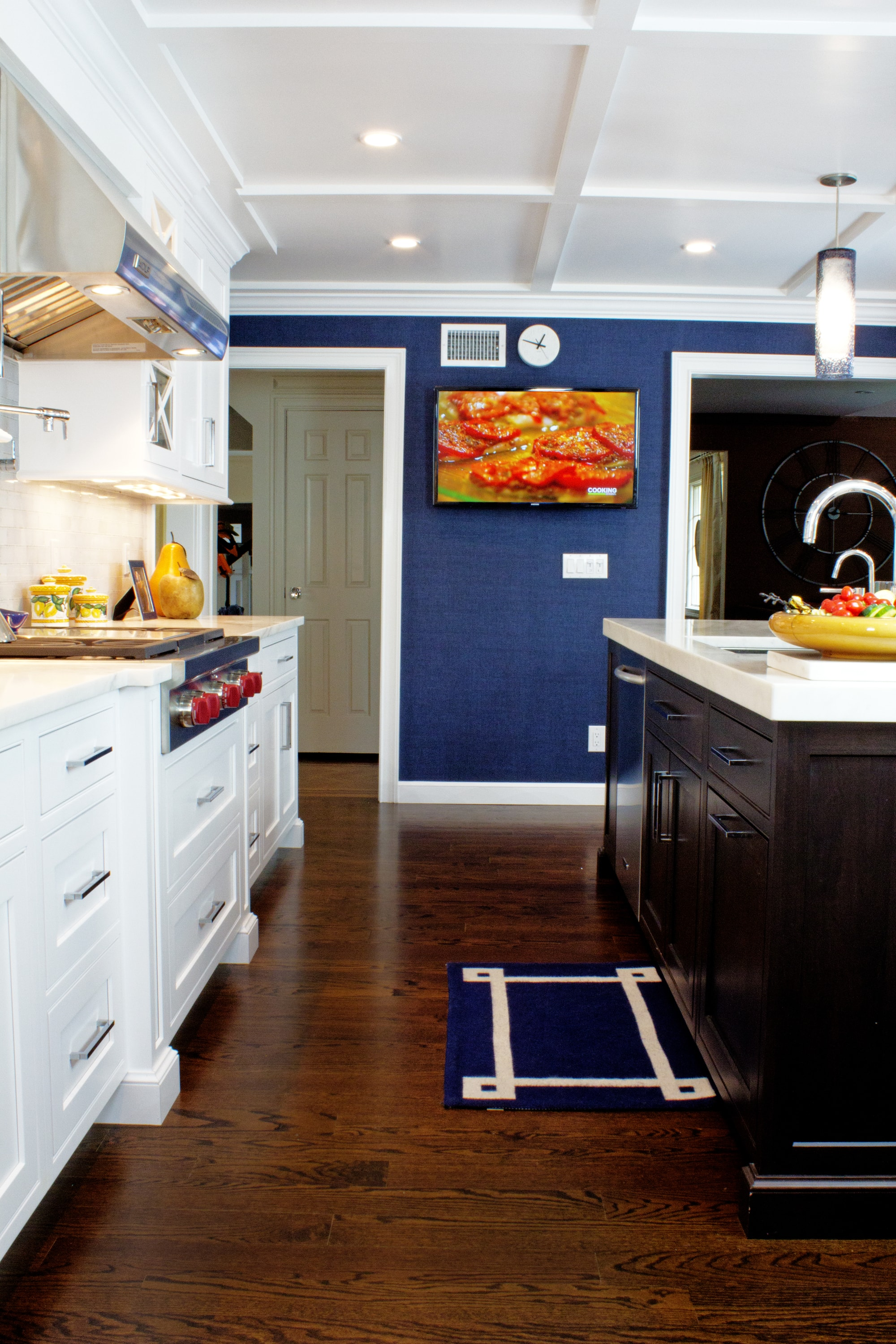 Transitional style kitchen with blue wall accent