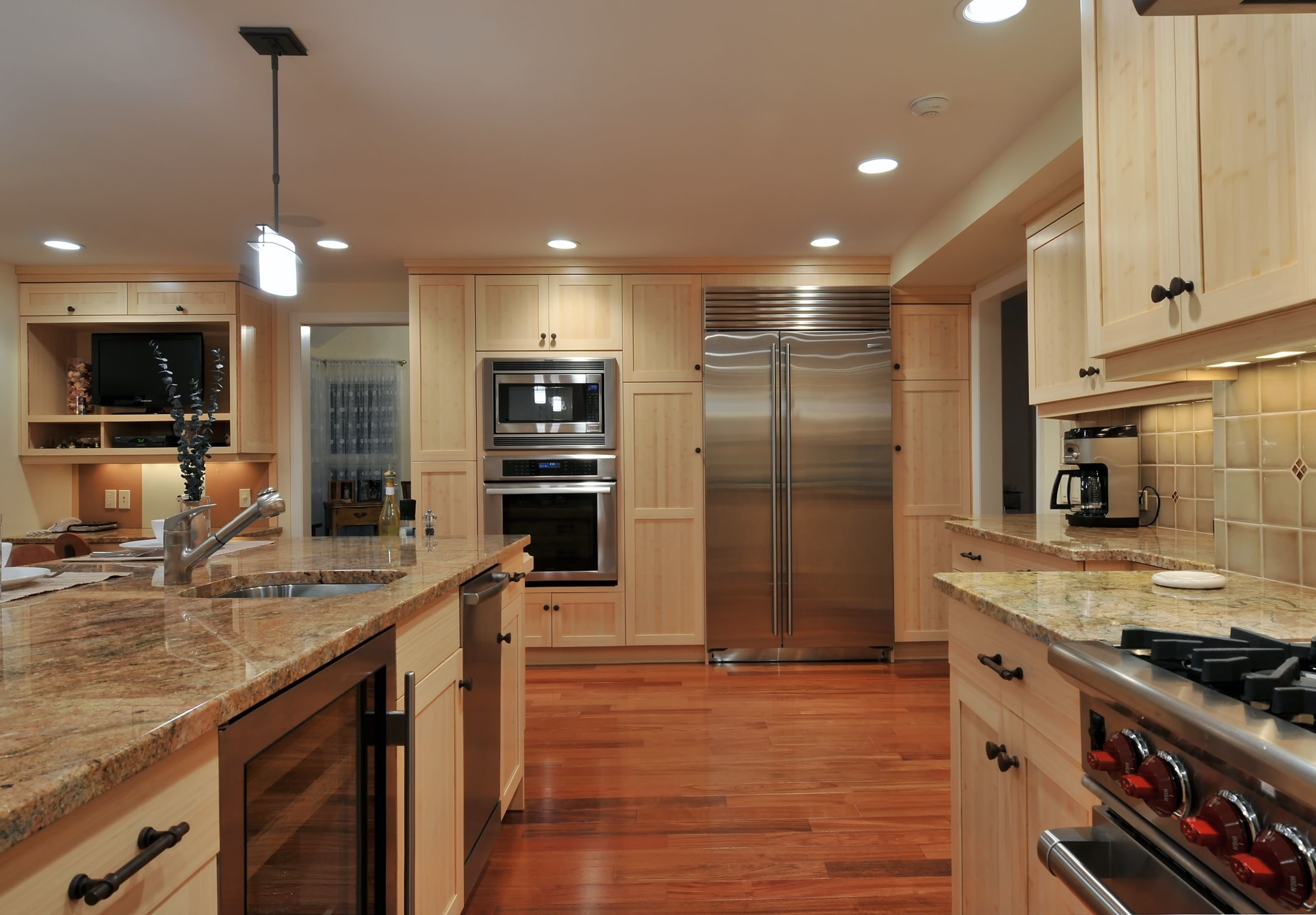 Transitional style kitchen with granite counter top