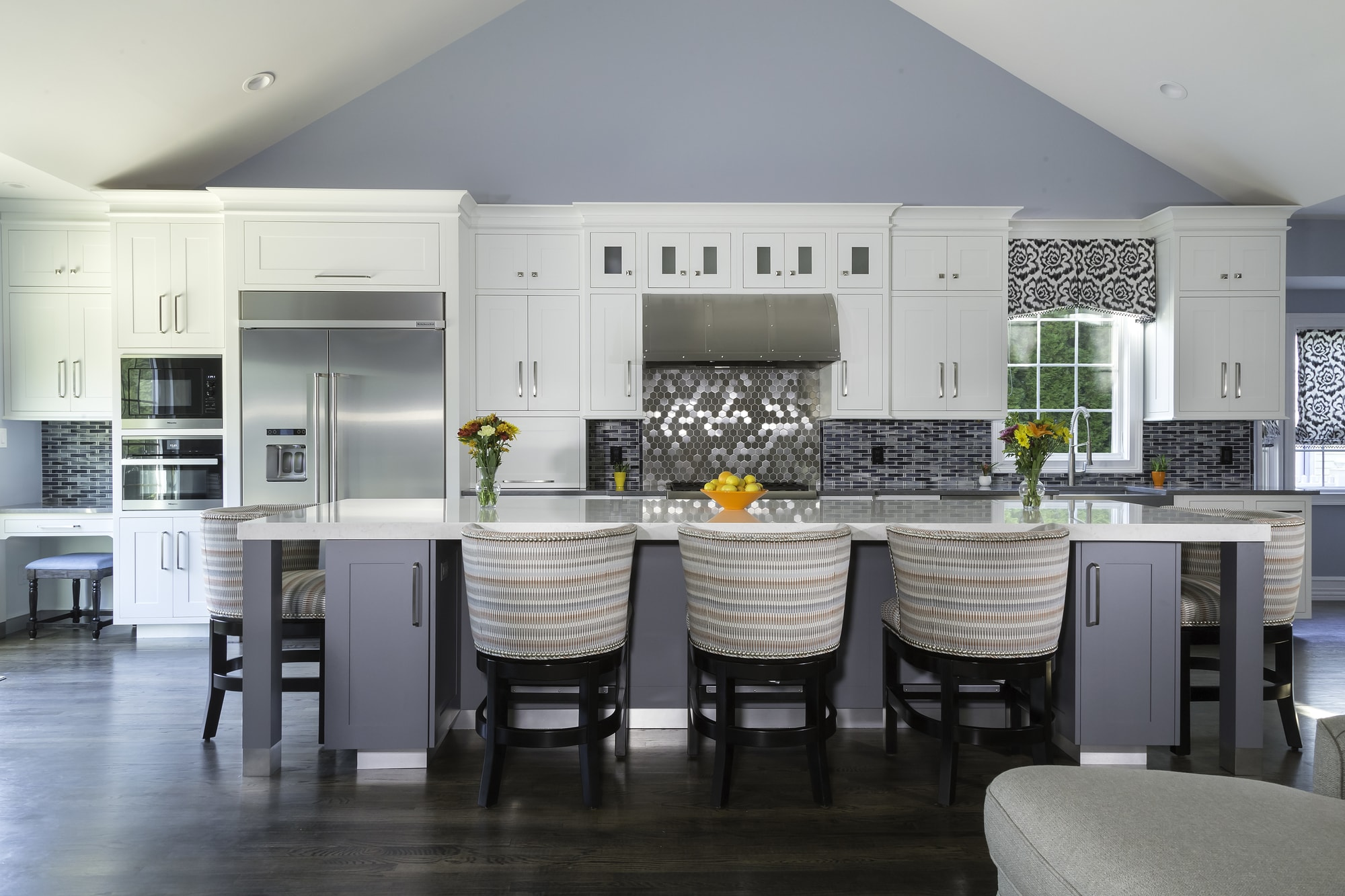 Transitional style kitchen with center island and breakfast table in one