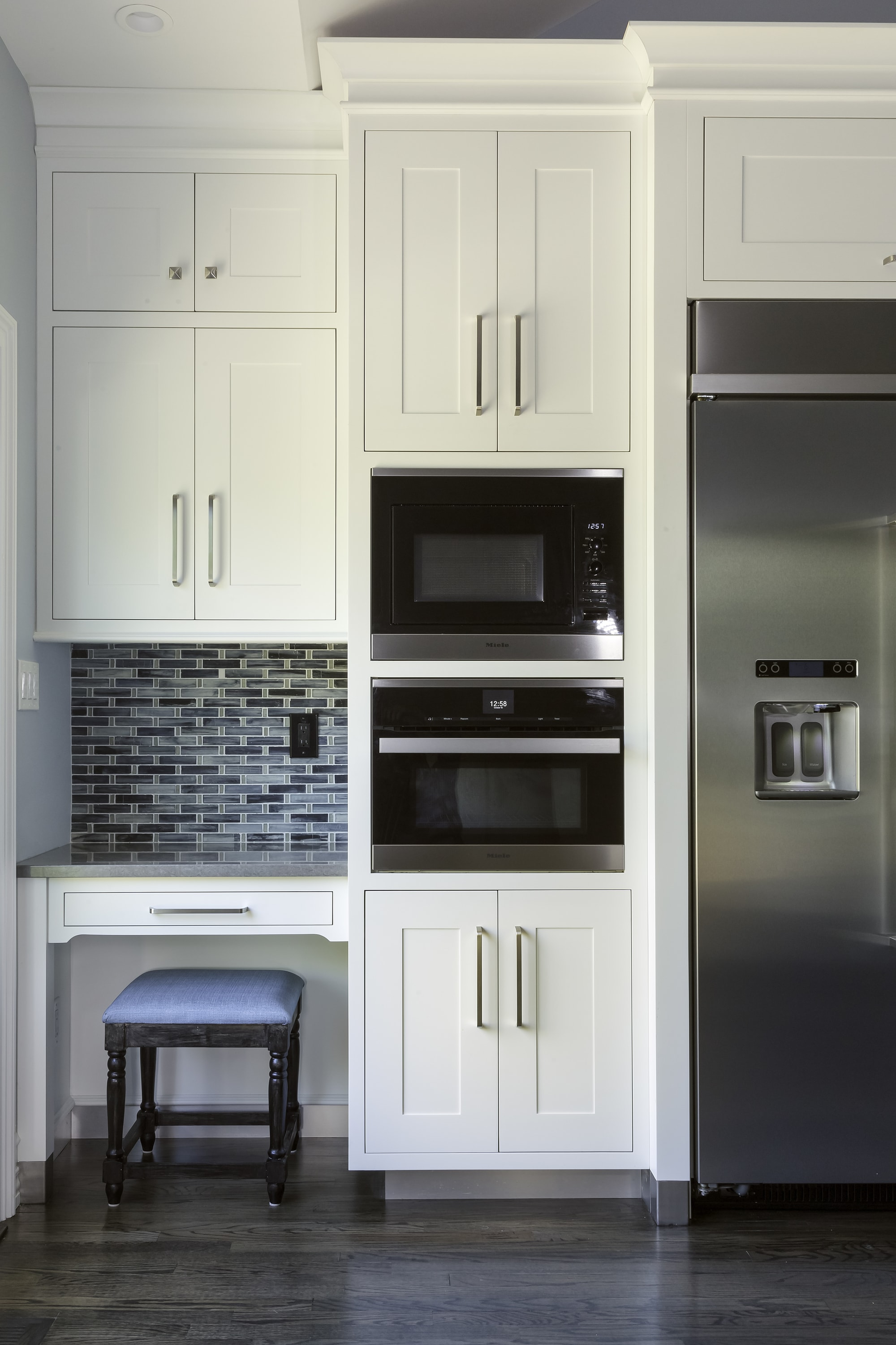 Transitional style kitchen with work table and speed cooking oven
