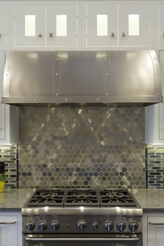 Transitional style kitchen with trendy backsplash