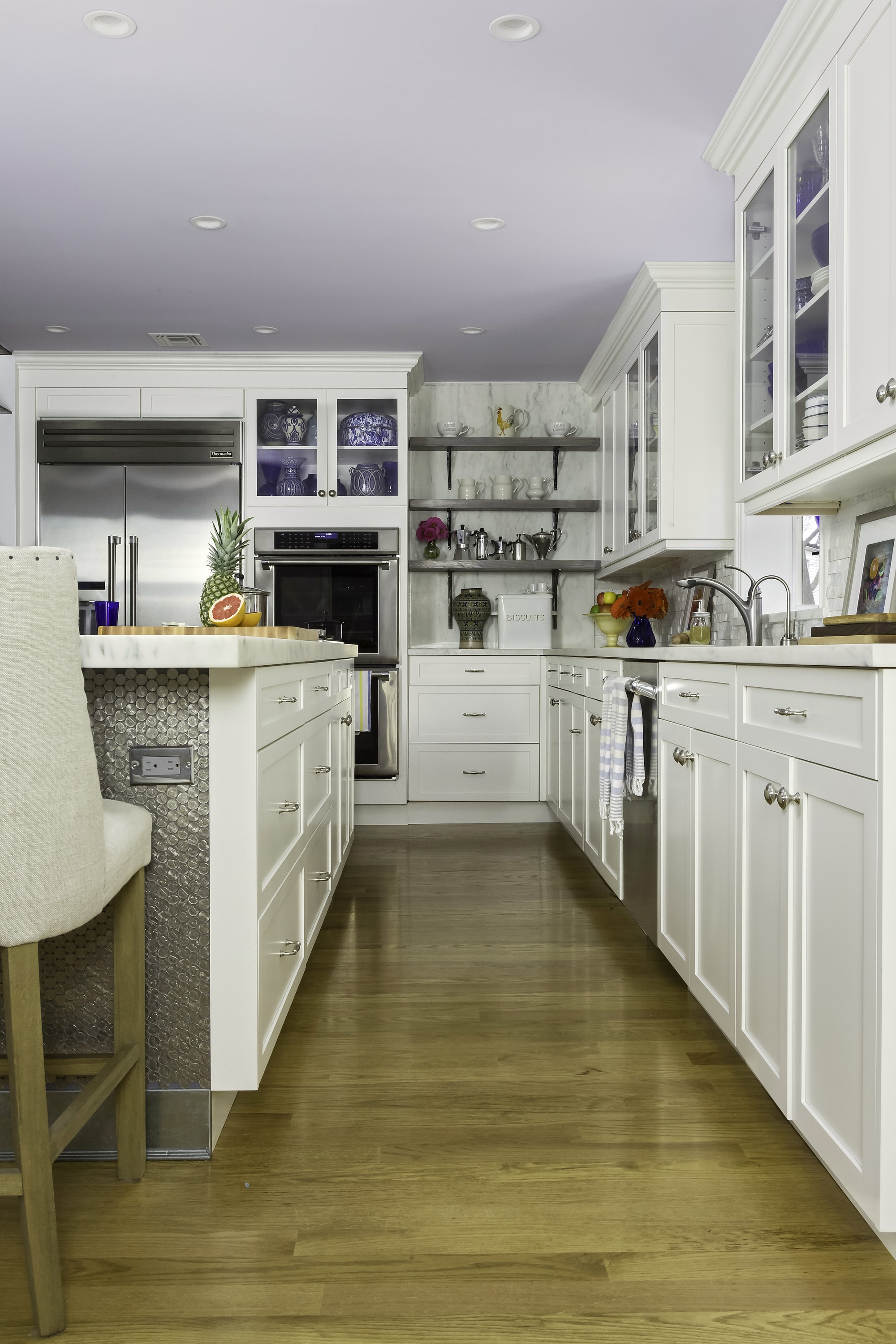 Transitional style kitchen with wooden floors