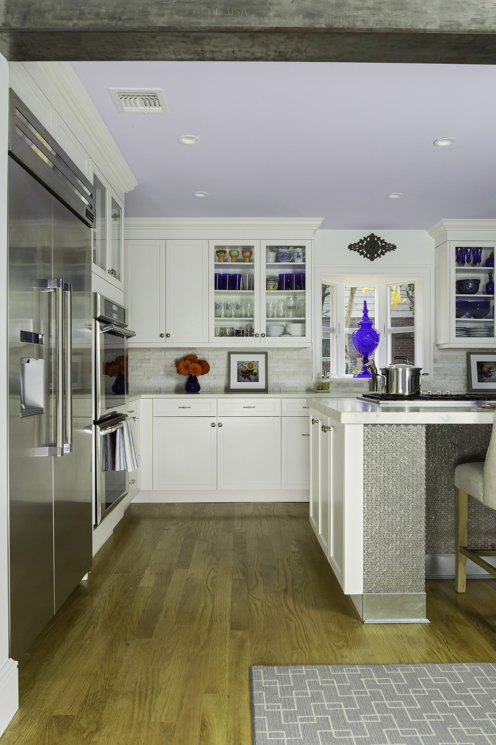 Transitional style kitchen with wooden and carpeted dining room