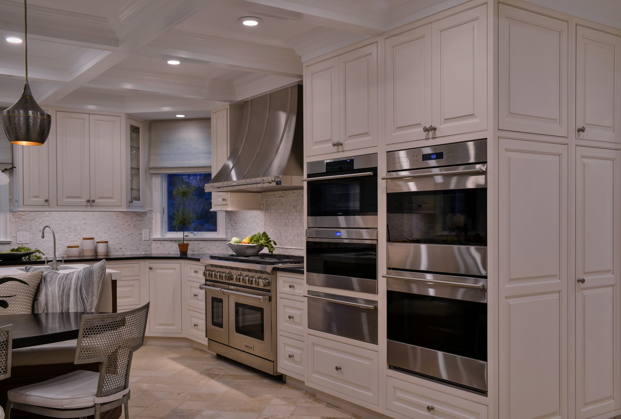 Transitional style kitchen with range oven and speed cooking oven