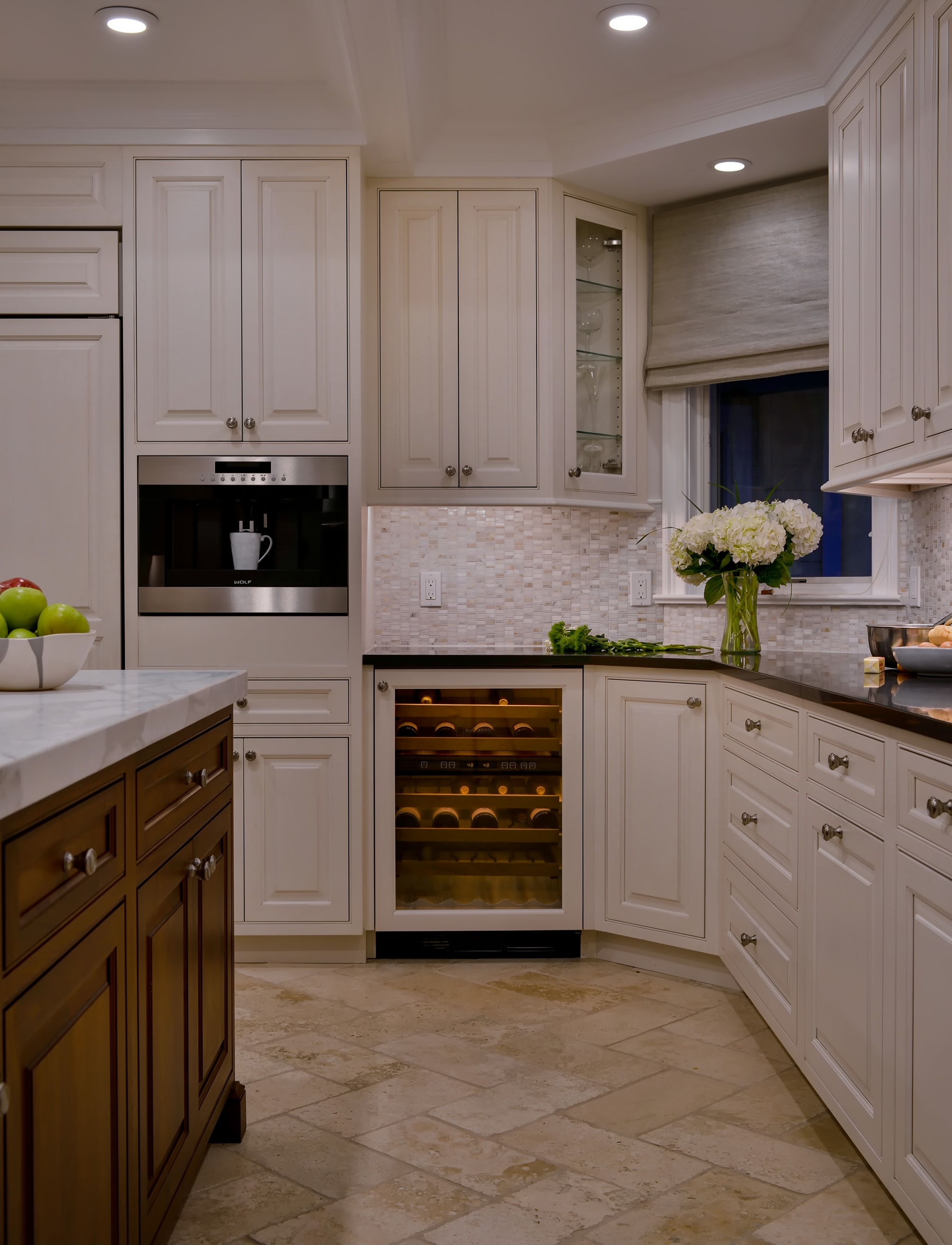 Transitional style kitchen with under counter wine cooler