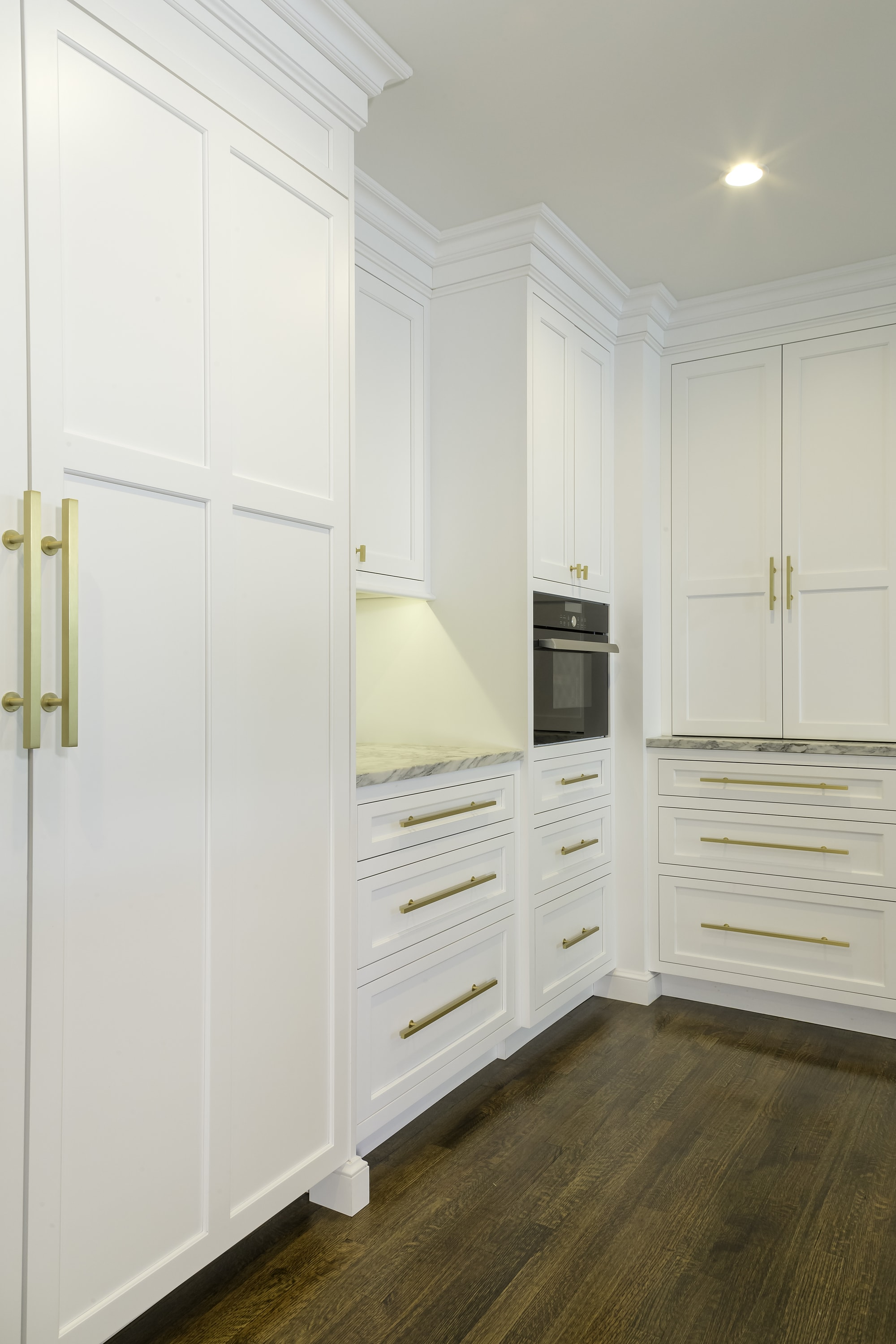 Transitional style kitchen with large cabinet for storage