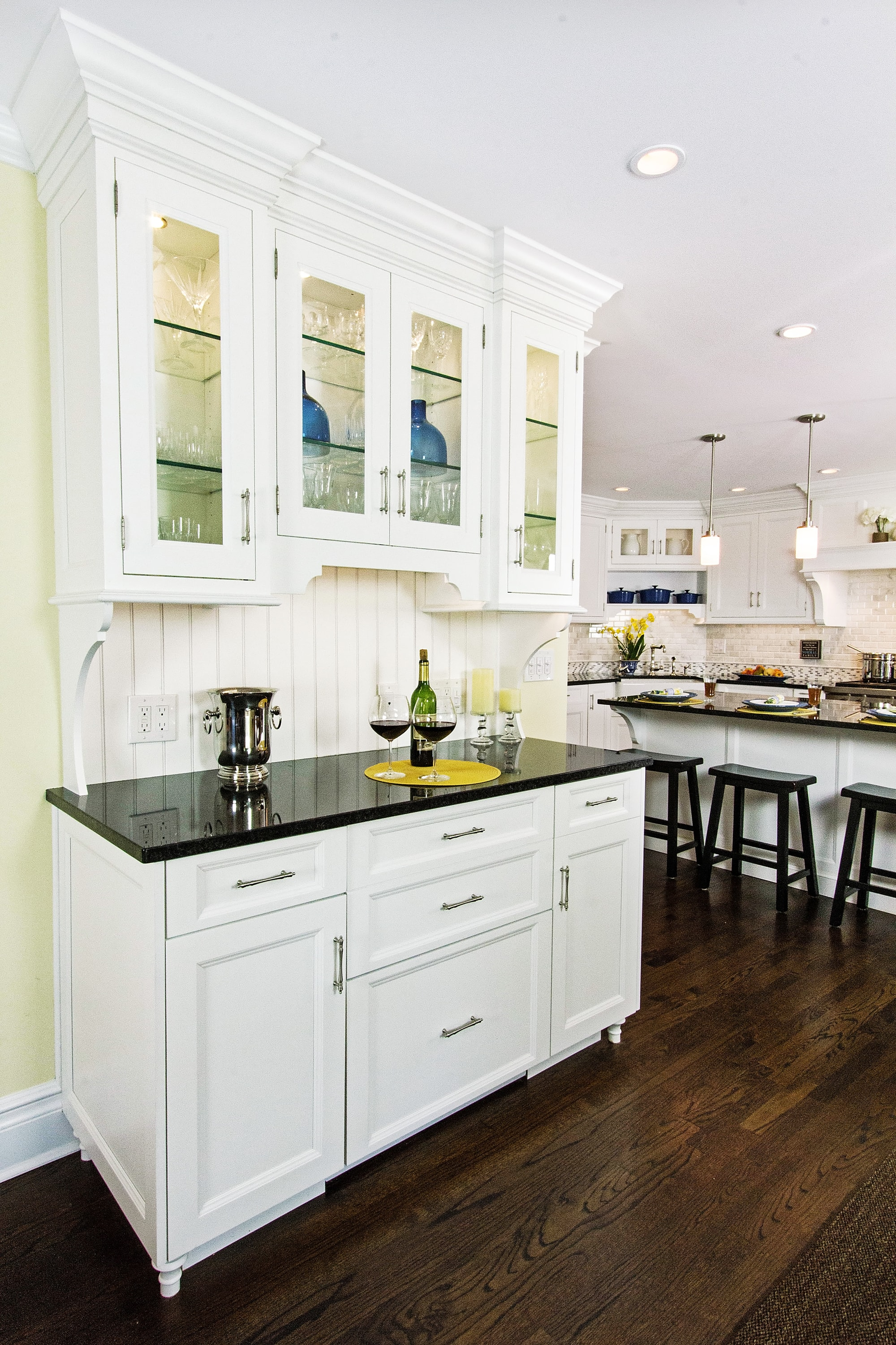 Transitional style kitchen with wine glass storage