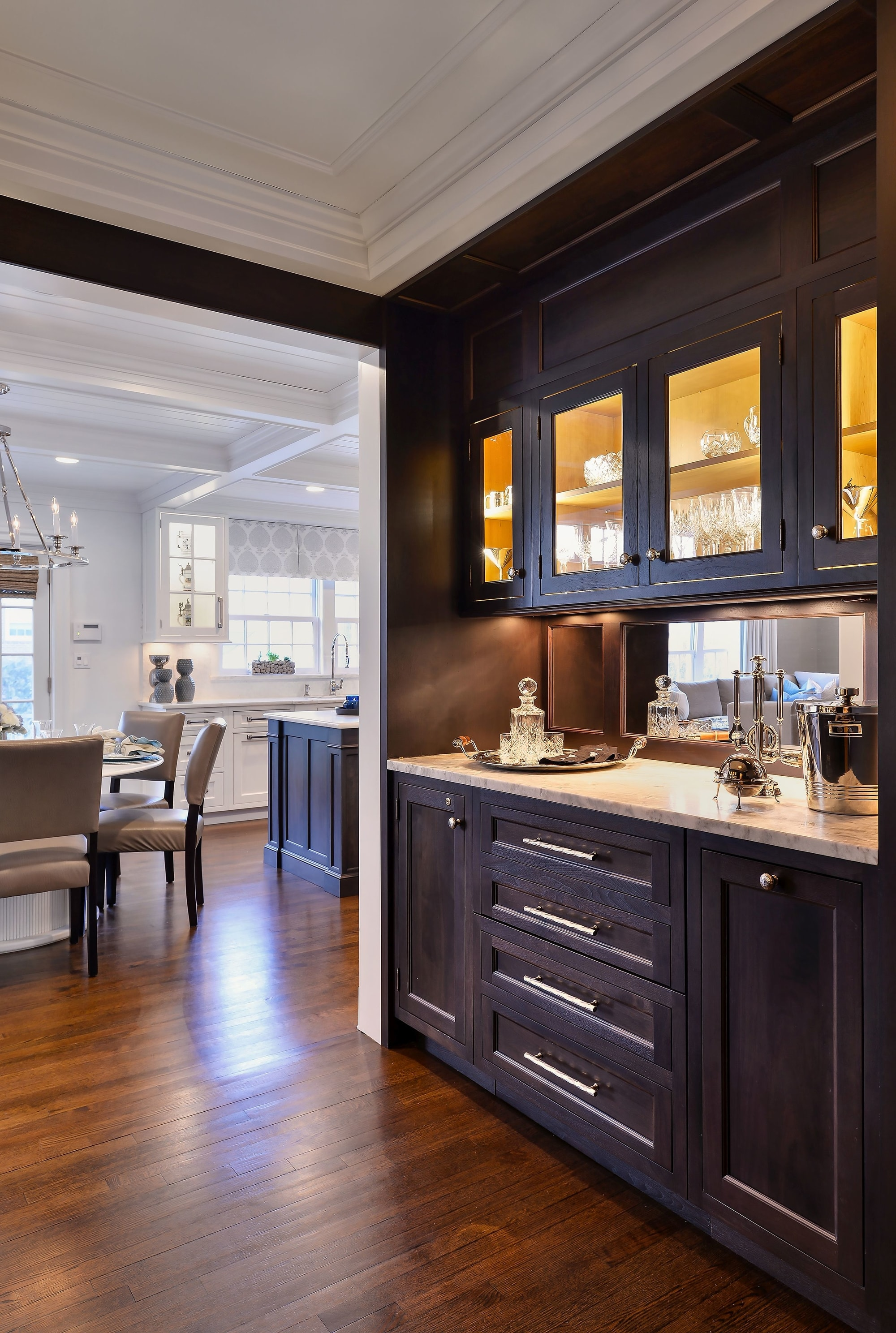Transitional style kitchen with wine bar counter