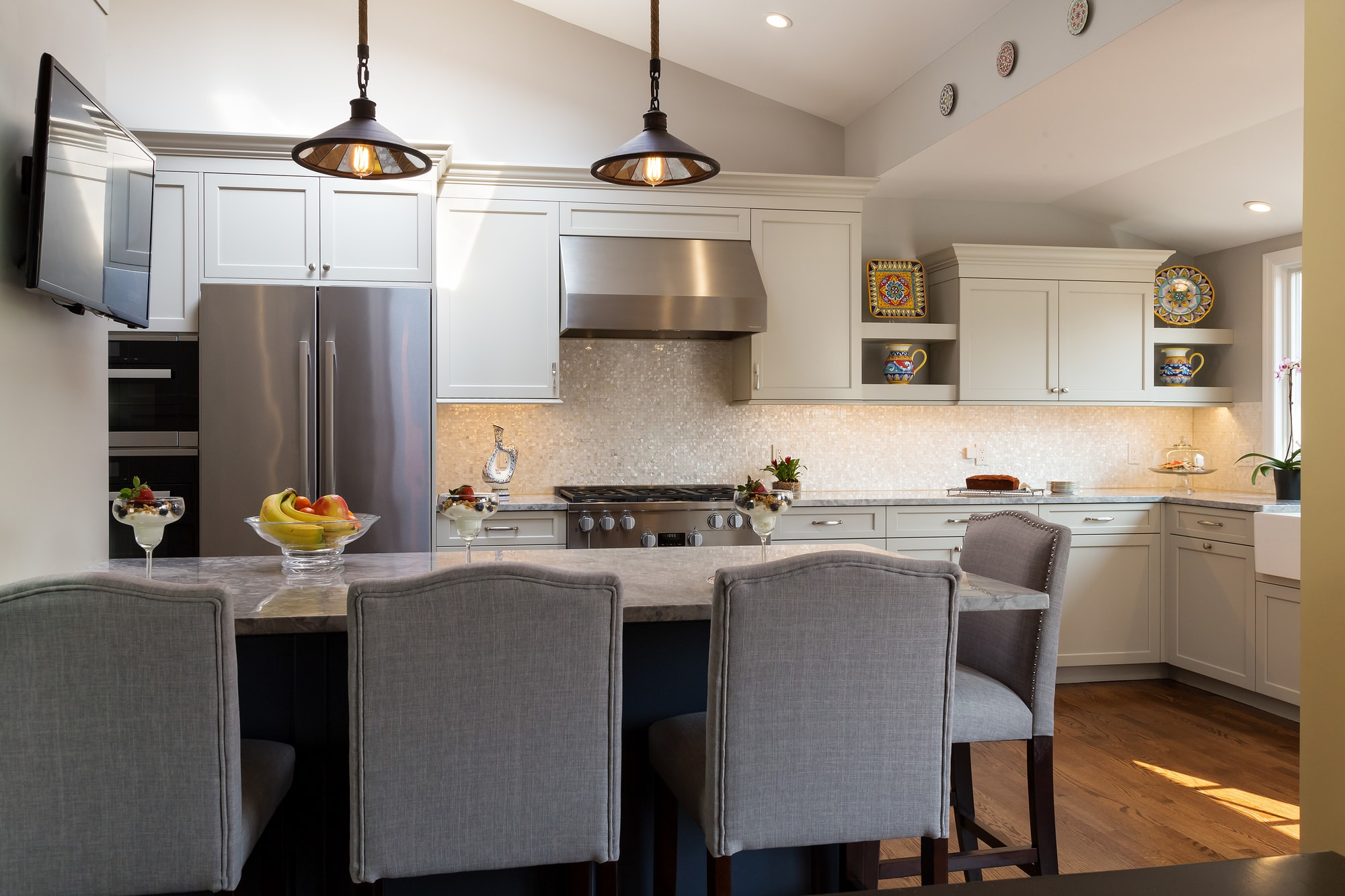 Transitional style kitchen with long breakfast table