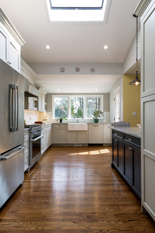 Transitional style kitchen with three kitchen bay window