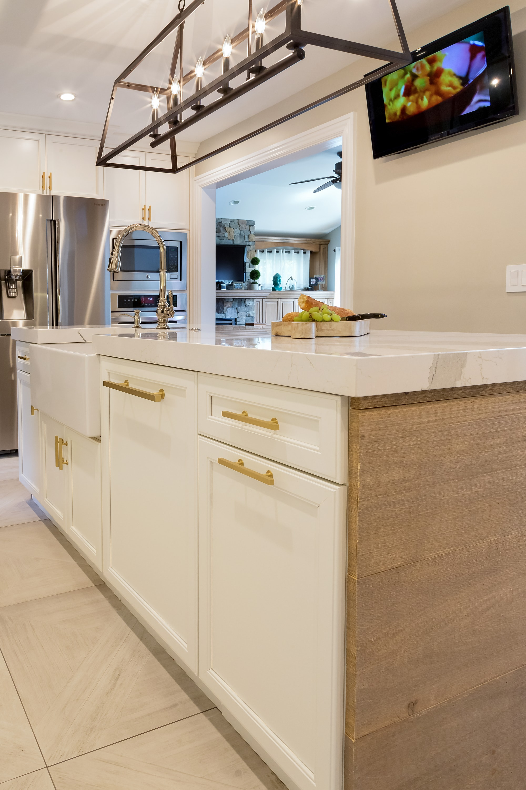 Transitional style kitchen with custom built pull out drawer on center island