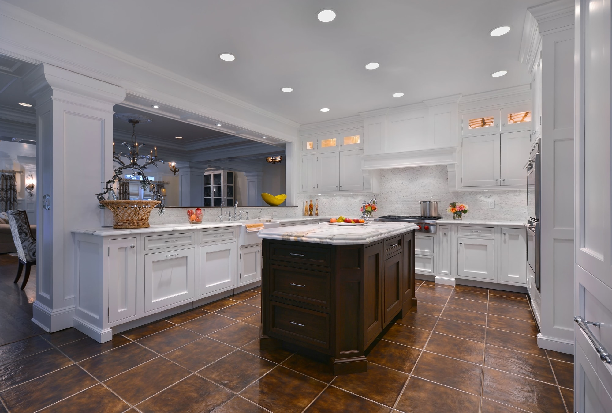 Transitional style kitchen with center island