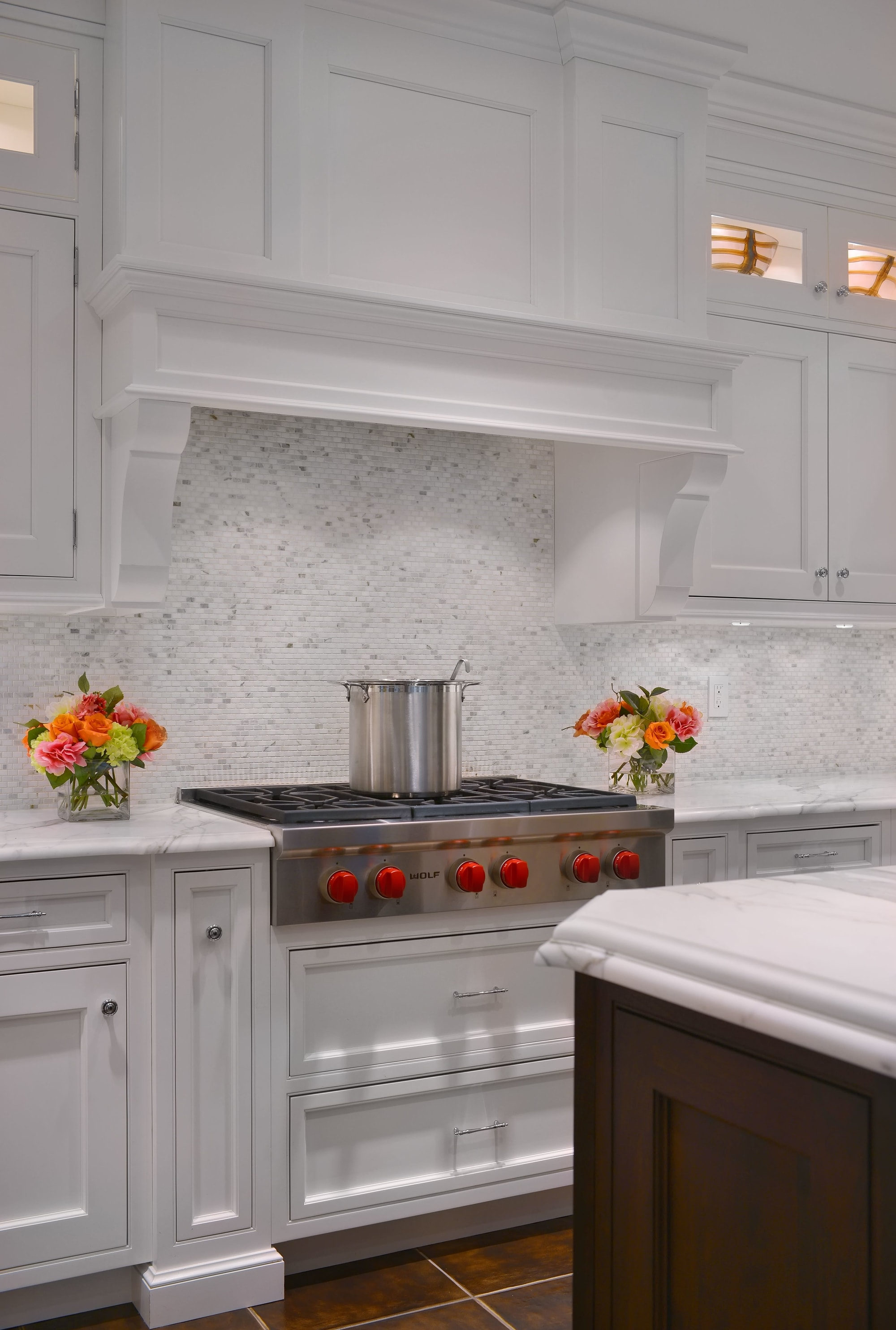 Transitional style kitchen with stainless range