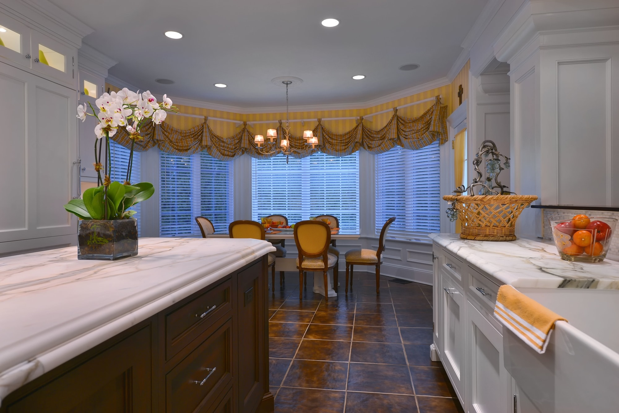 Transitional style kitchen with large windows and blinds