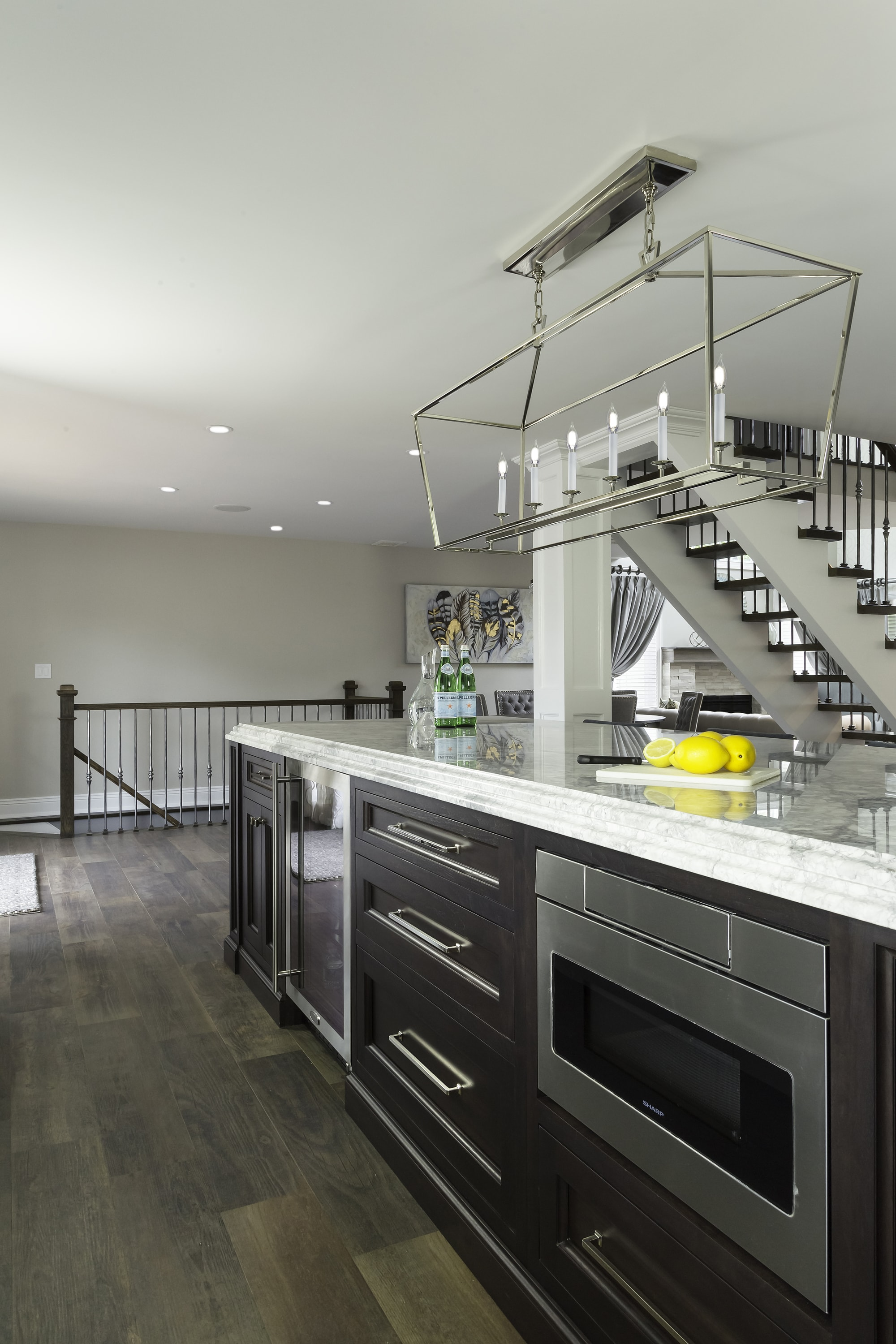 Transitional style kitchen with built in cabinet on center island