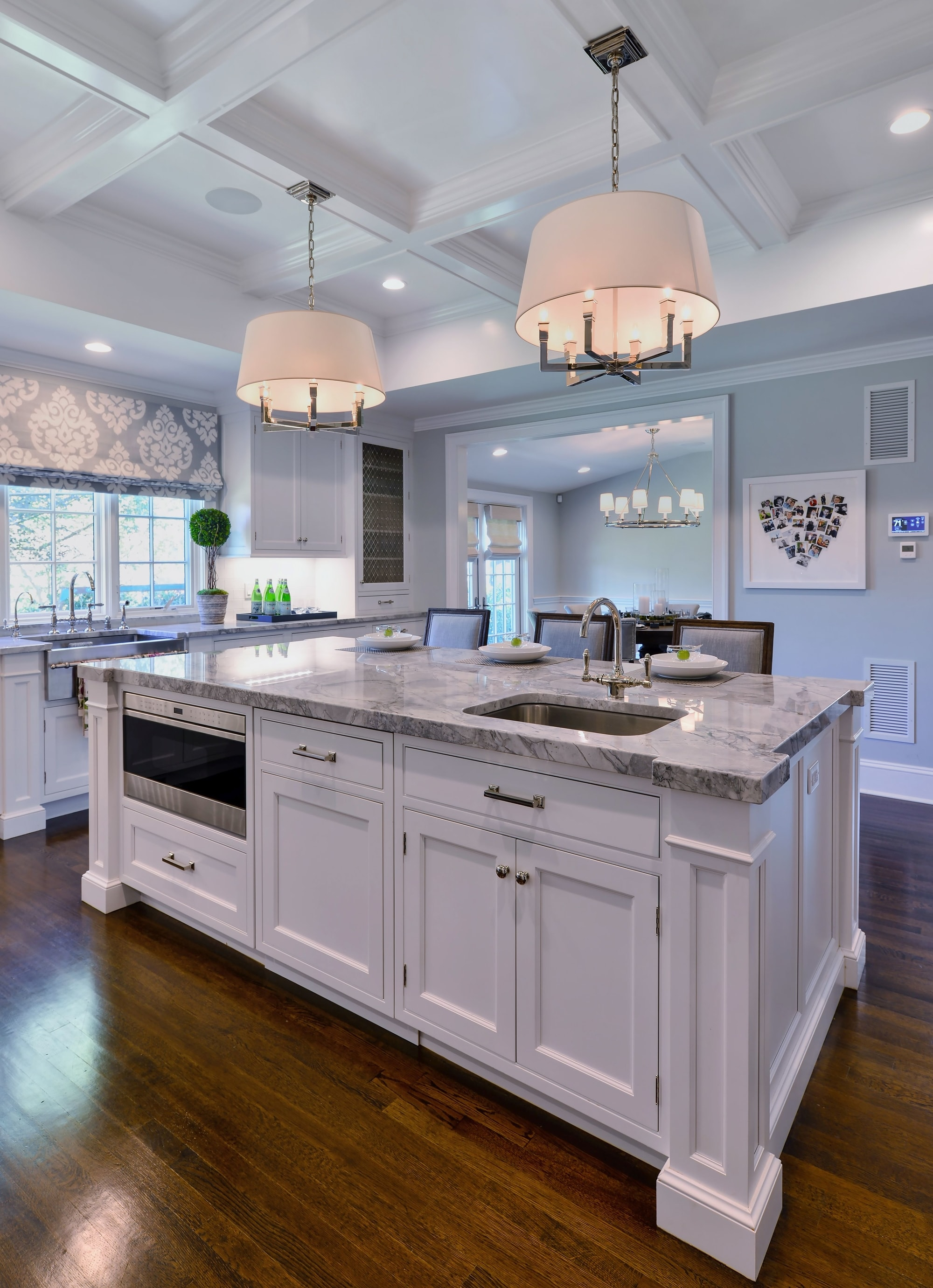 Transitional style kitchen with custom built drawers at the center island