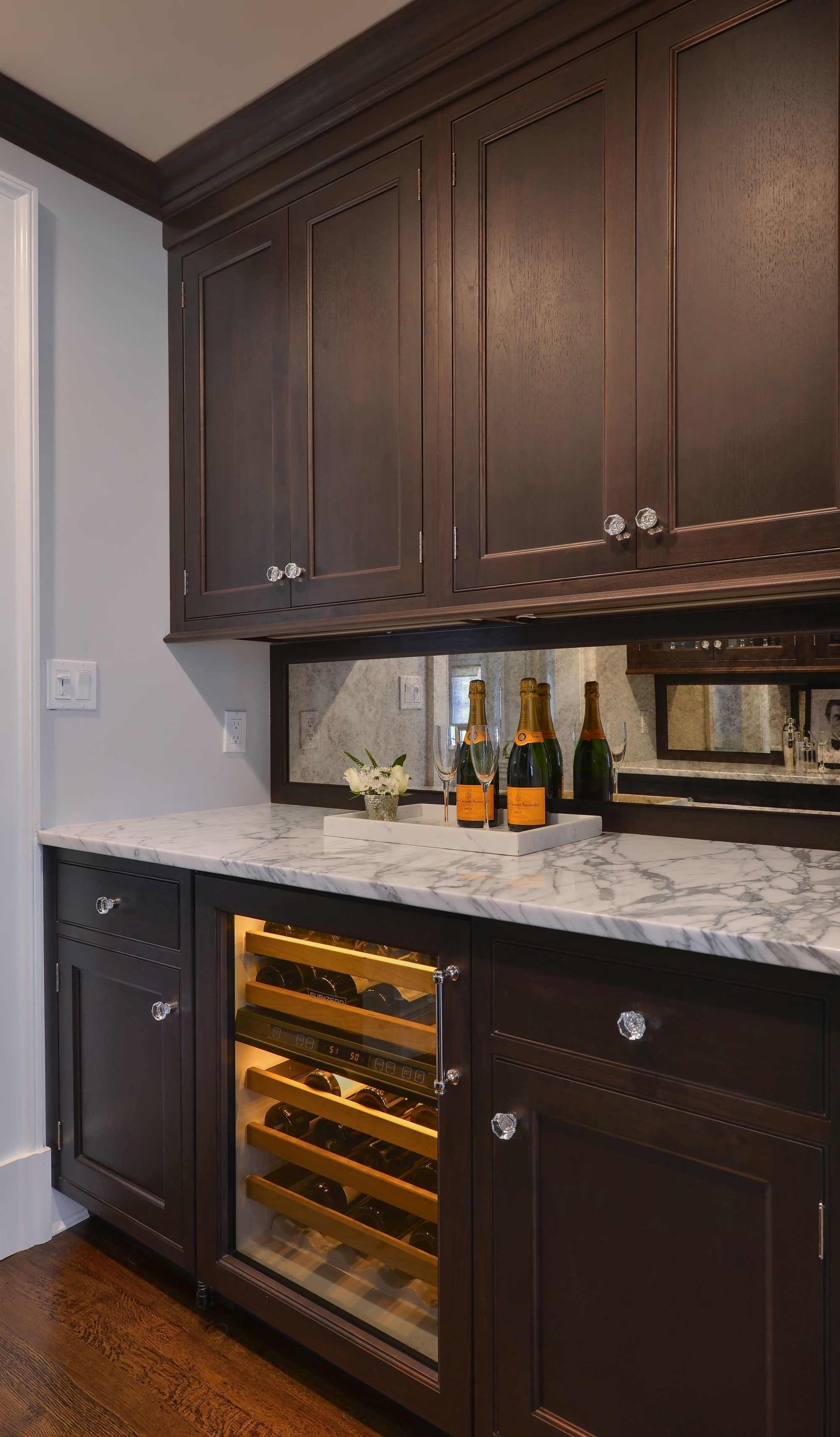 Transitional style kitchen with wine storage and cabinets
