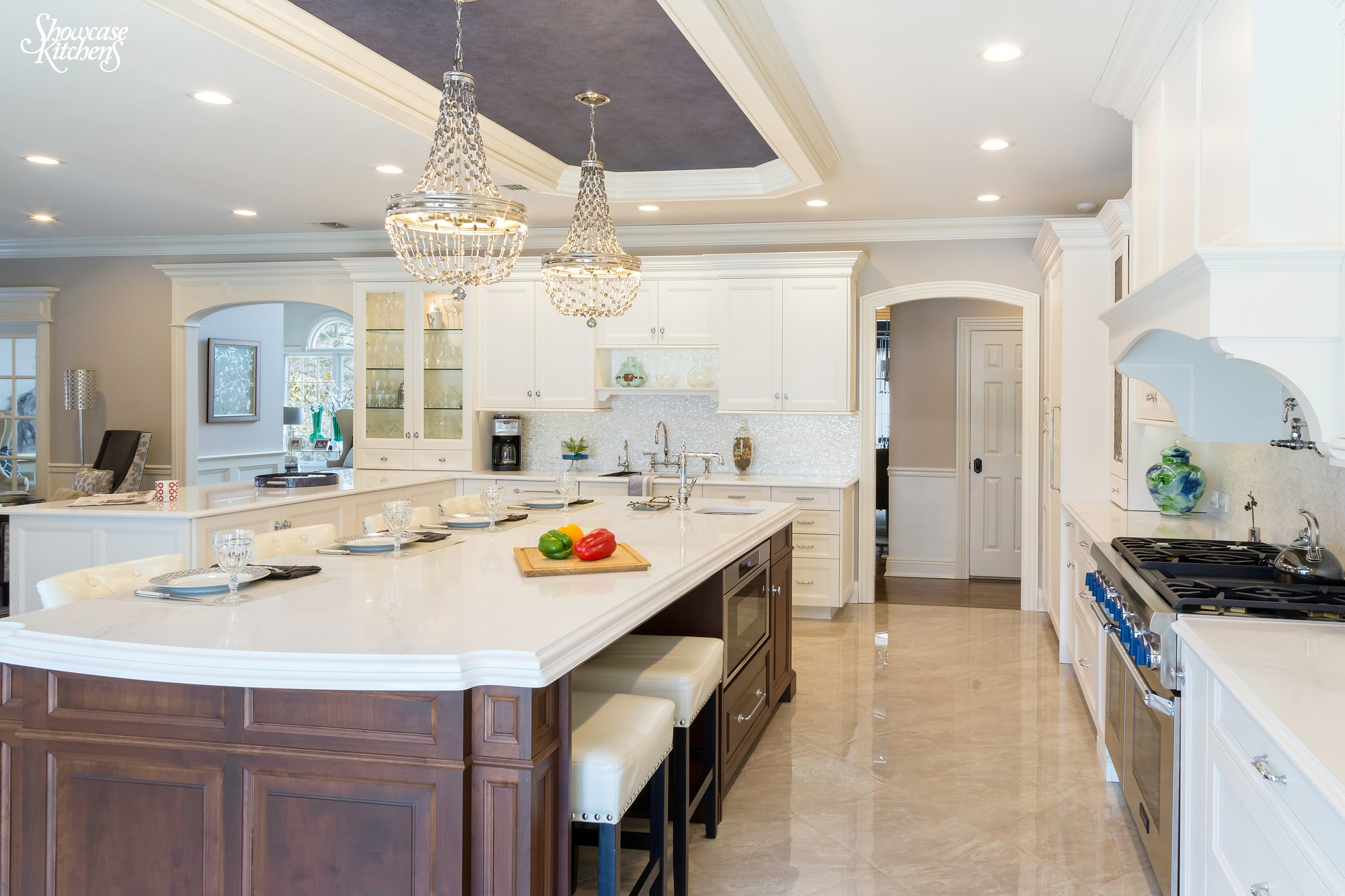 Transitional style kitchen with counter stools and chairs at the center island
