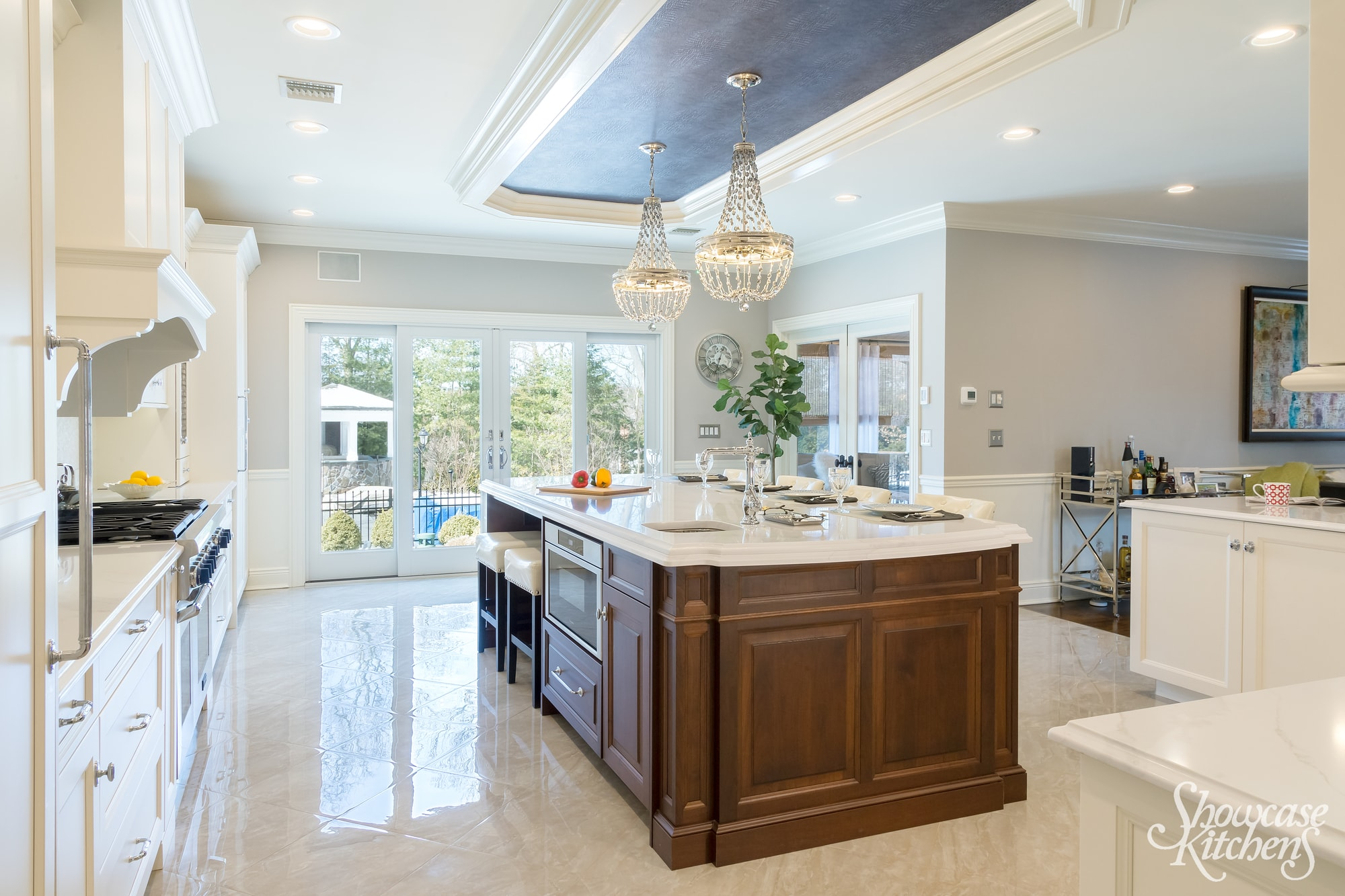 Transitional style kitchen with two grand pendant light fixtures