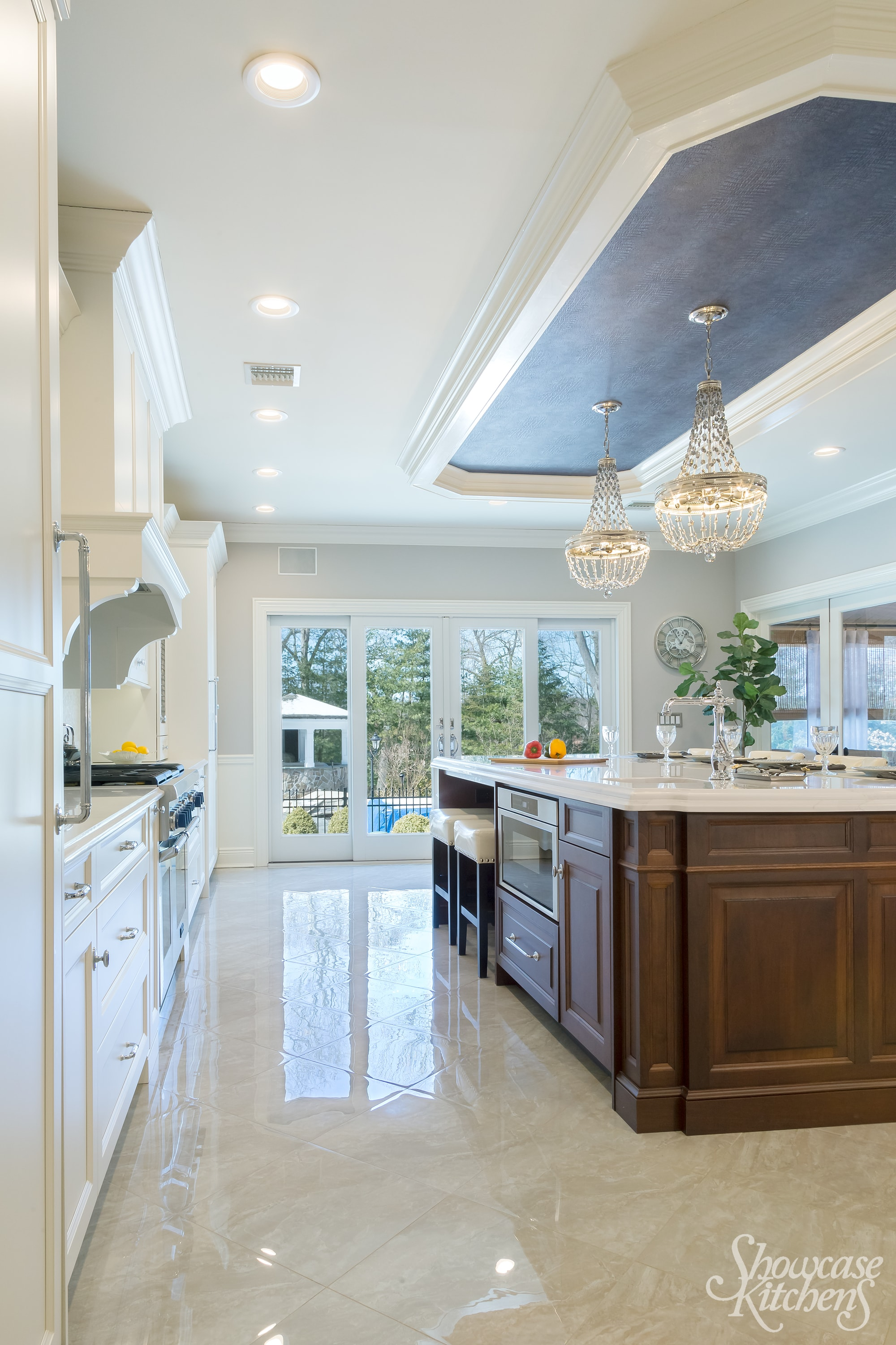 Transitional style kitchen with wooden center island and marble countertop