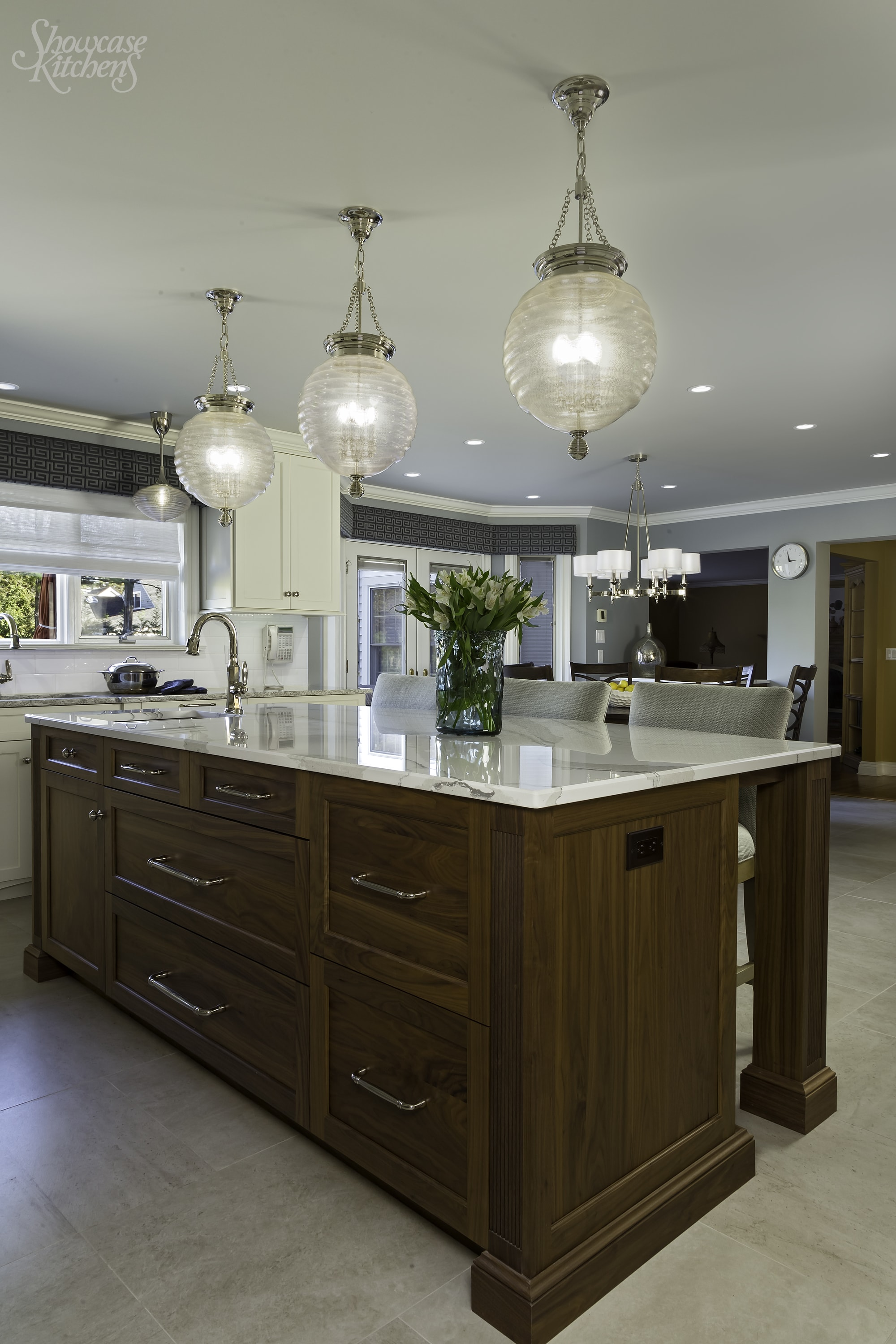 Transitional style kitchen with center island and three counter stool