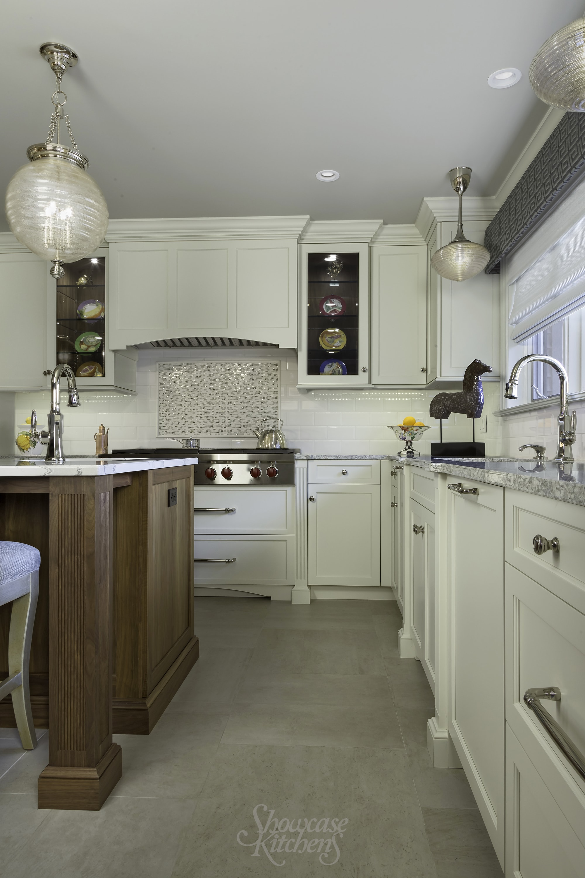 Transitional style kitchen with custom built pull out drawers on center island