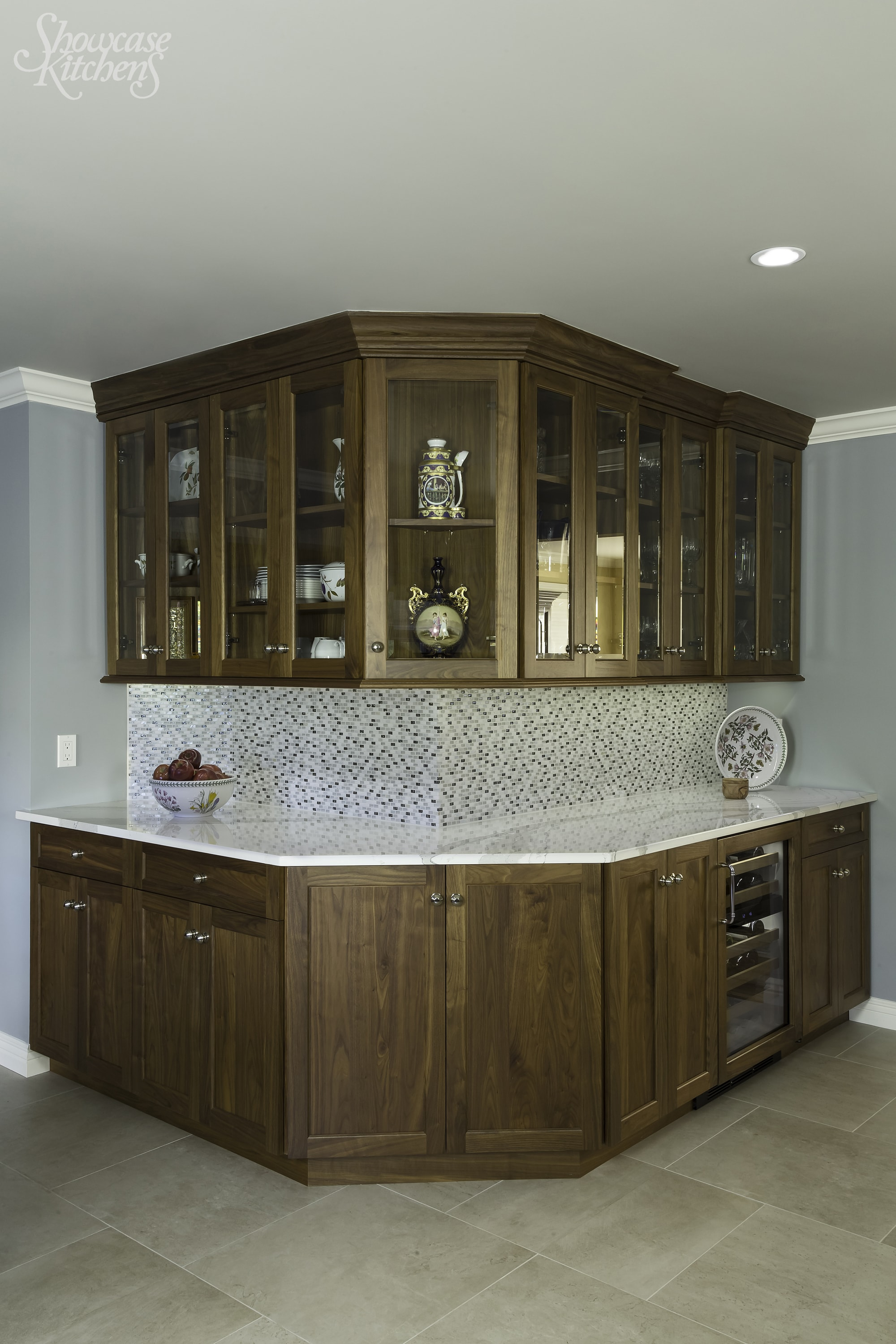 Transitional style kitchen with white marble countertop