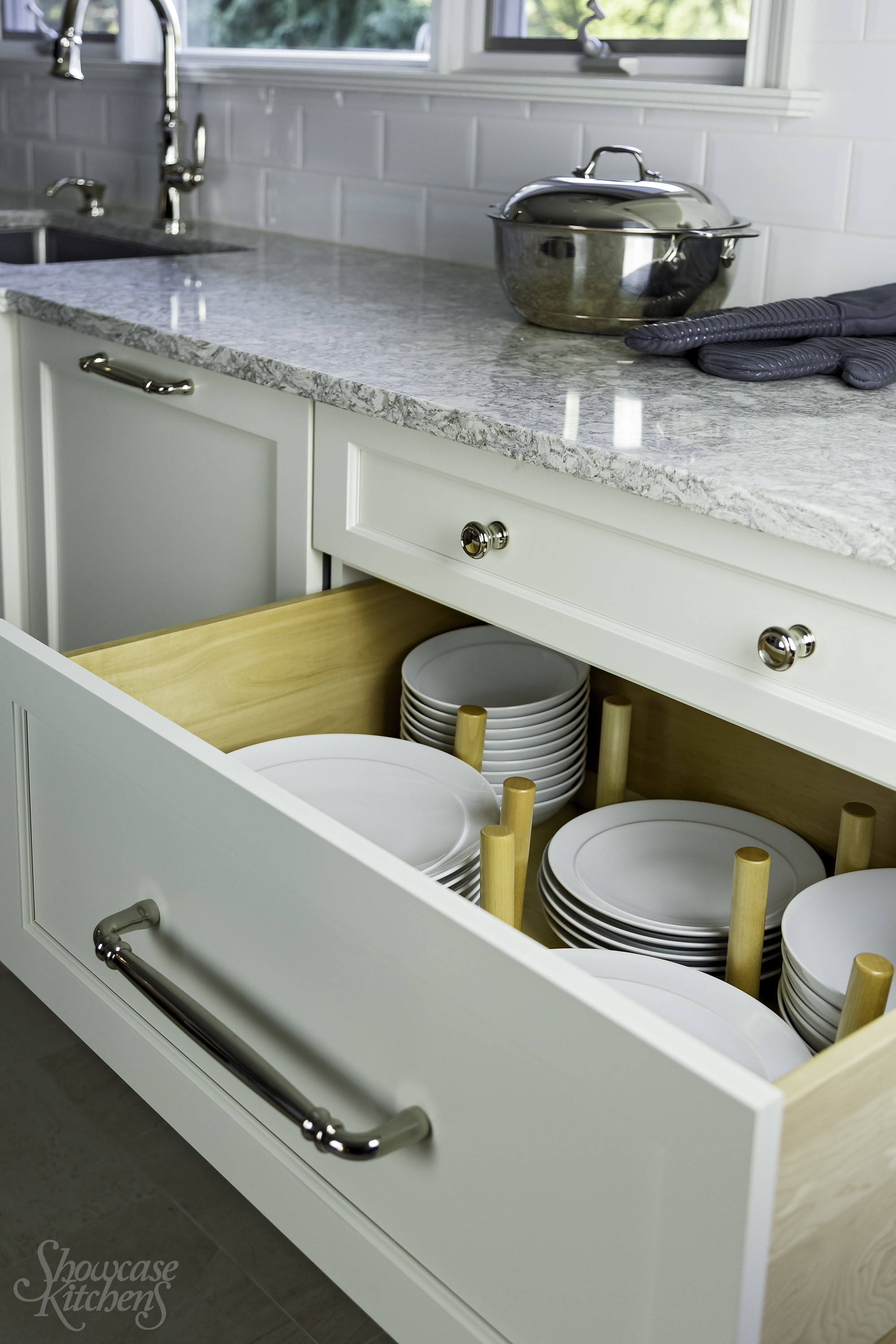 Transitional style kitchen with granite countertop and a pull out drawer