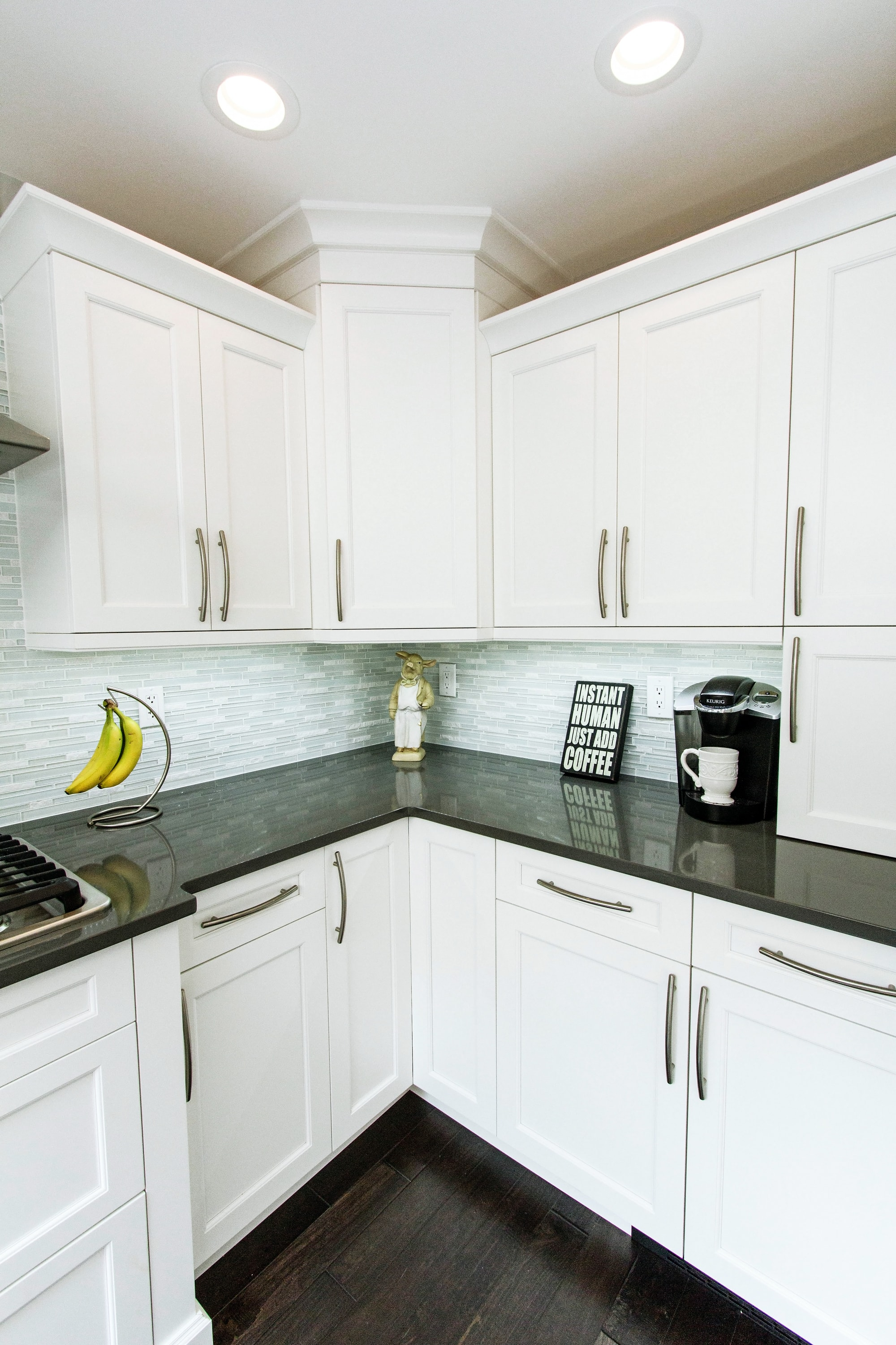 Transitional style kitchen with black countertop