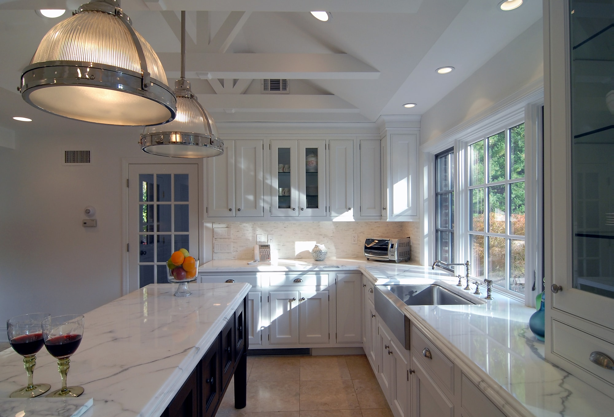 Transitional style kitchen with two modern light fixtures
