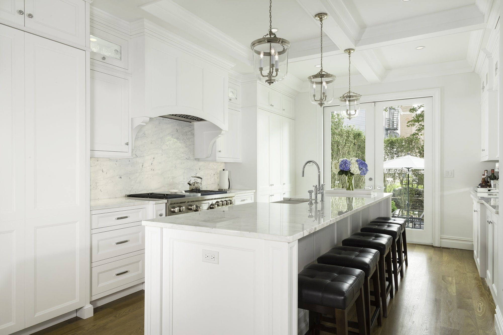 Transitional style kitchen with long and white kitchen island