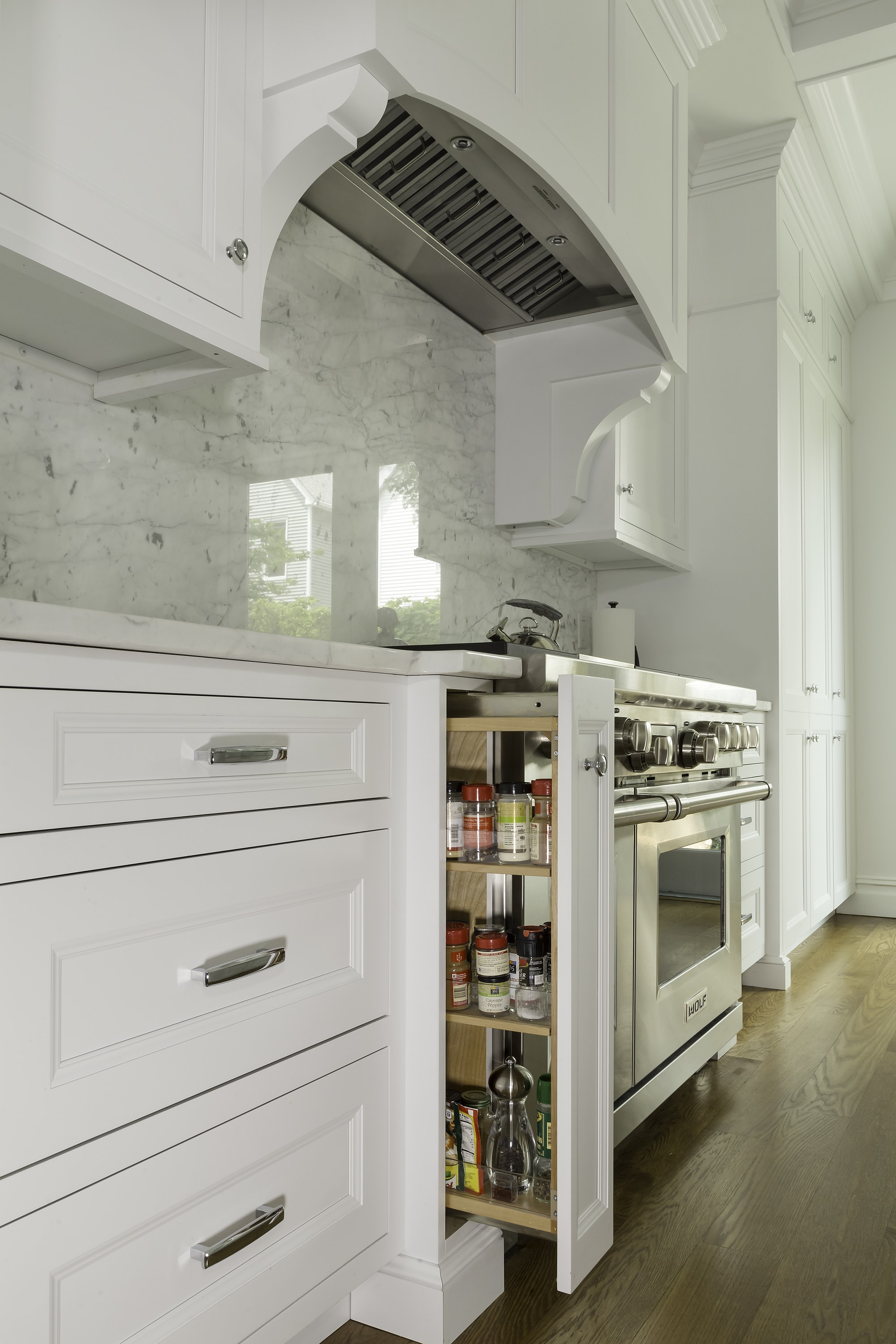 Transitional style kitchen with space saving storage