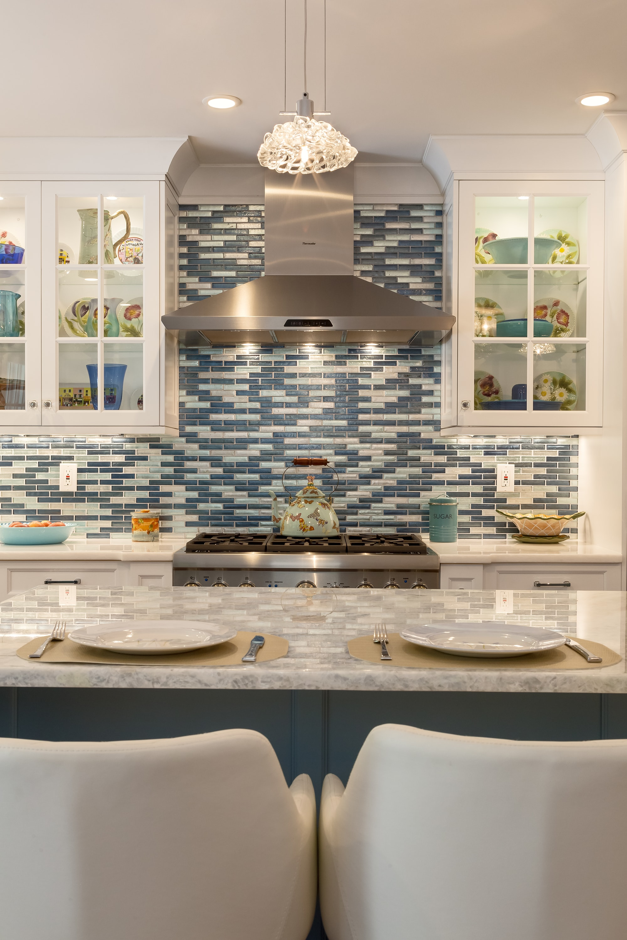 Transitional style kitchen with tiled backsplash
