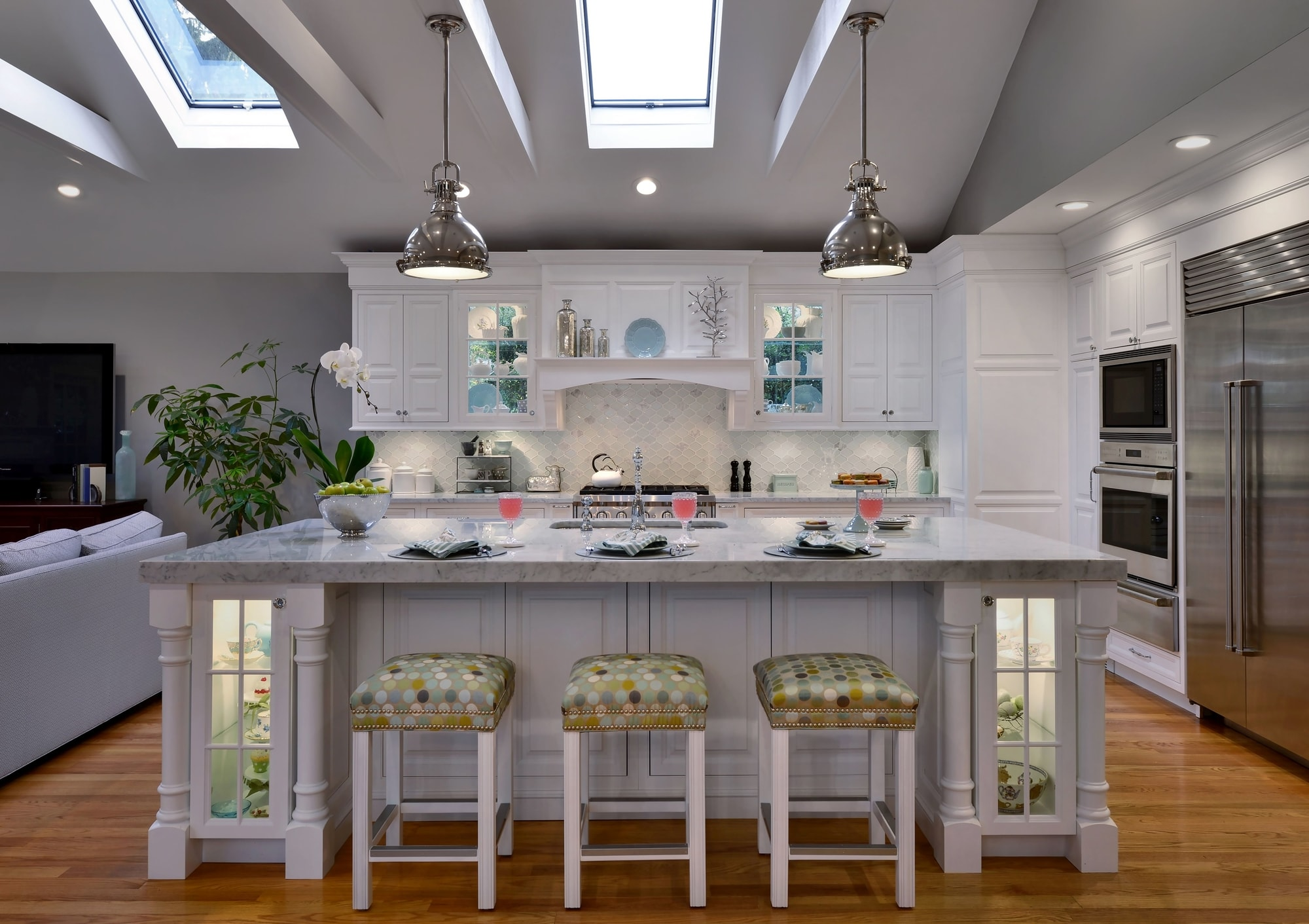 Transitional style kitchen with center island and three counter stools