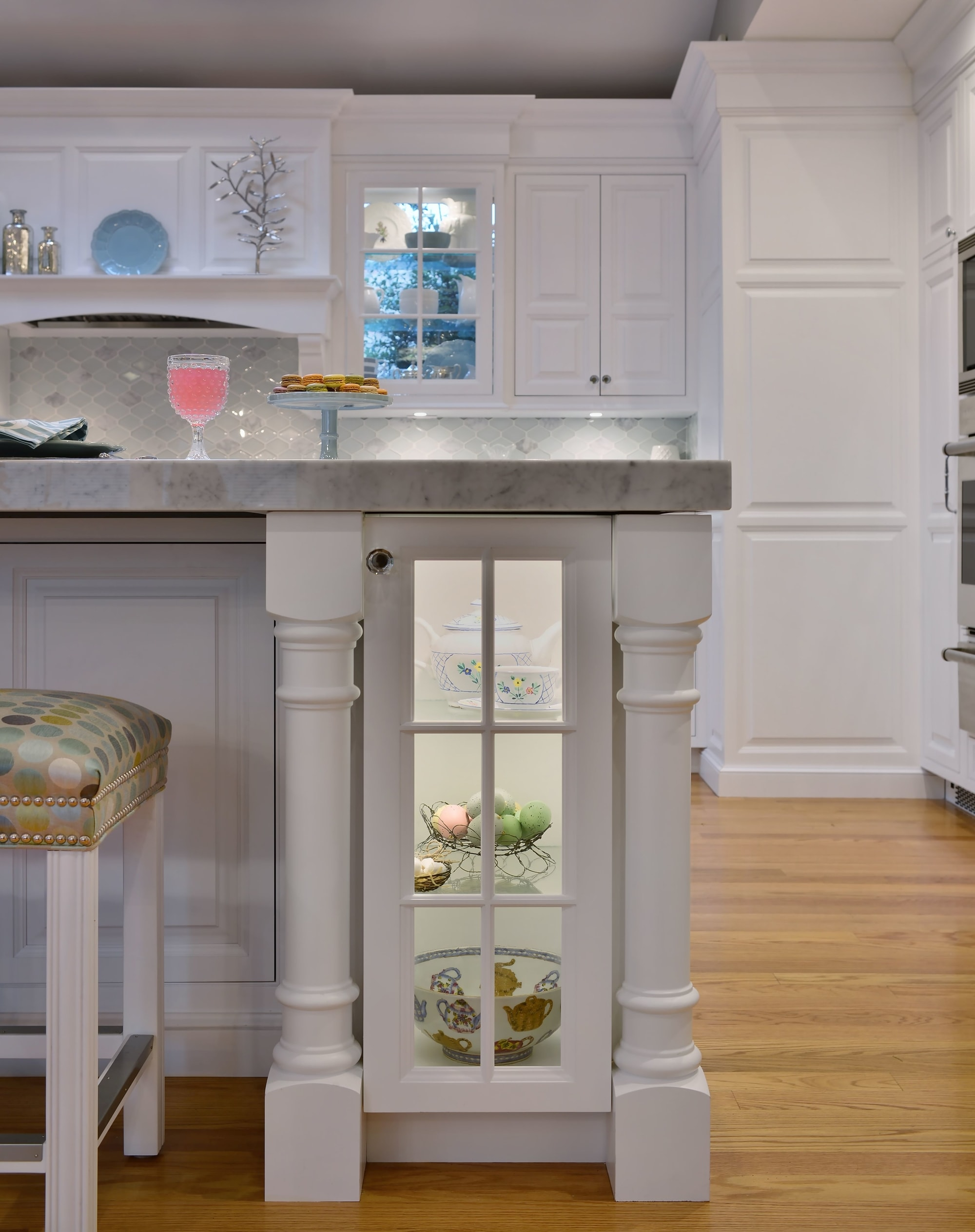 Transitional style kitchen with under counter glass door storage