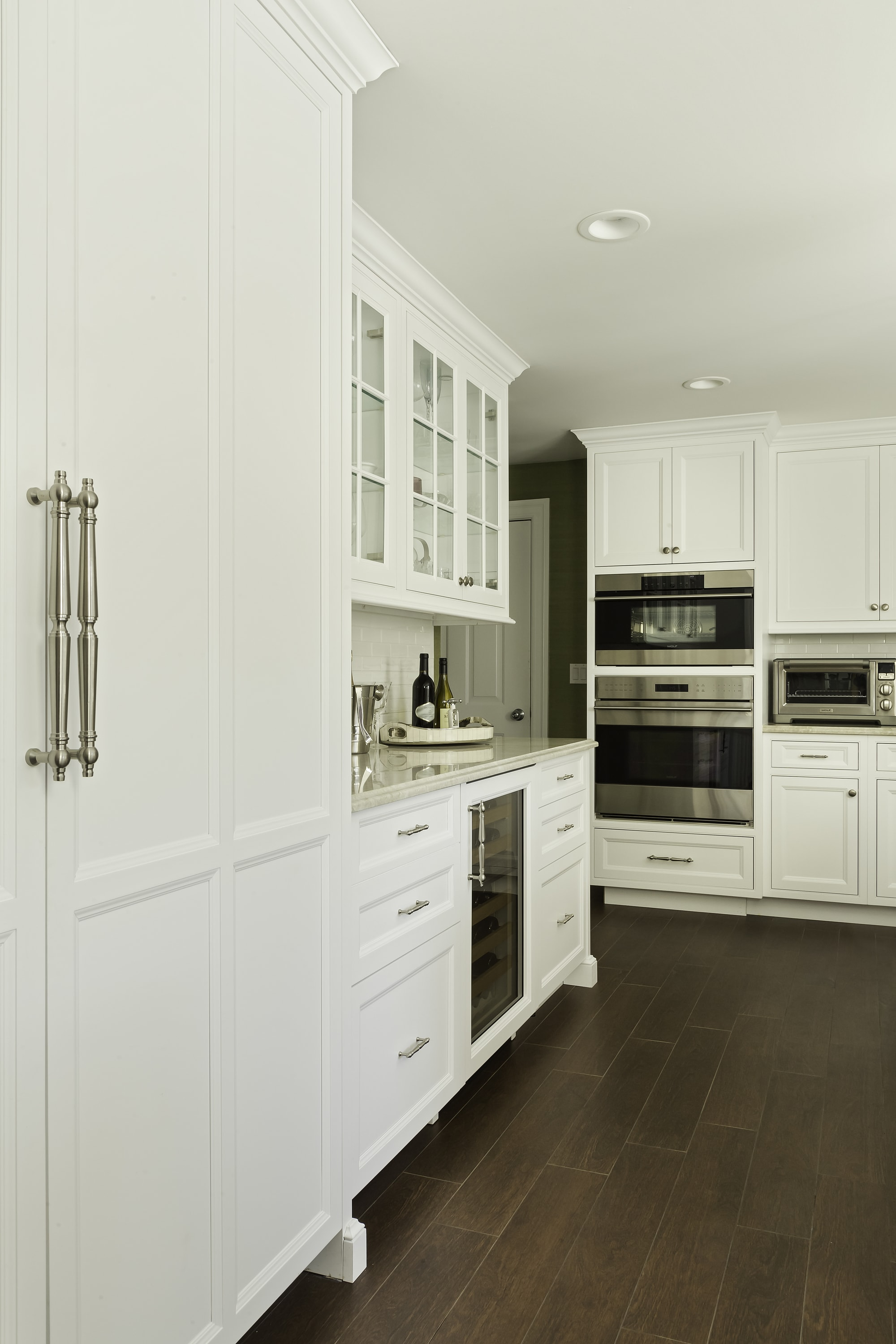 Transitional style kitchen with large cabinet