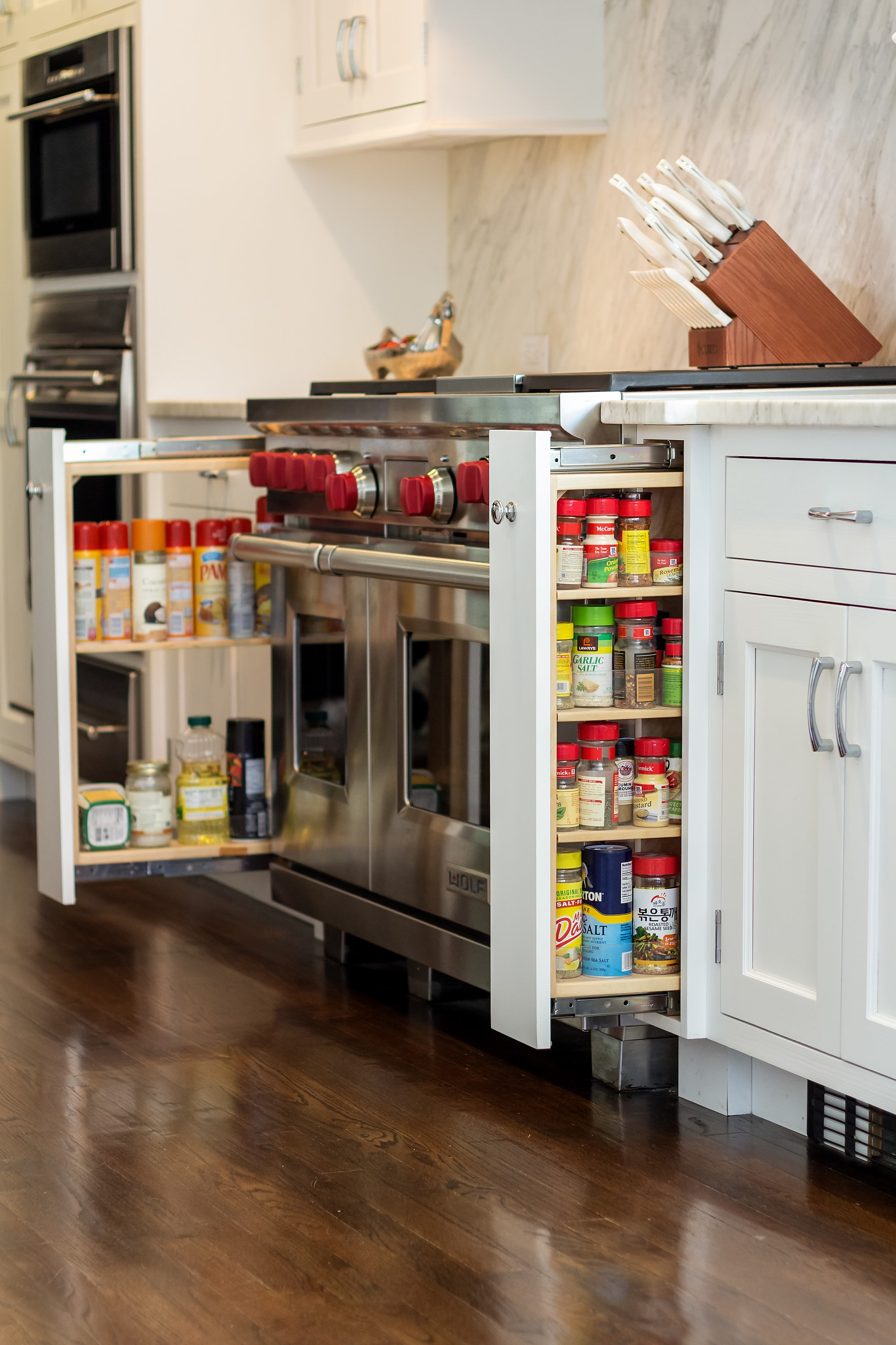 Transitional style kitchen with space saving cabinet