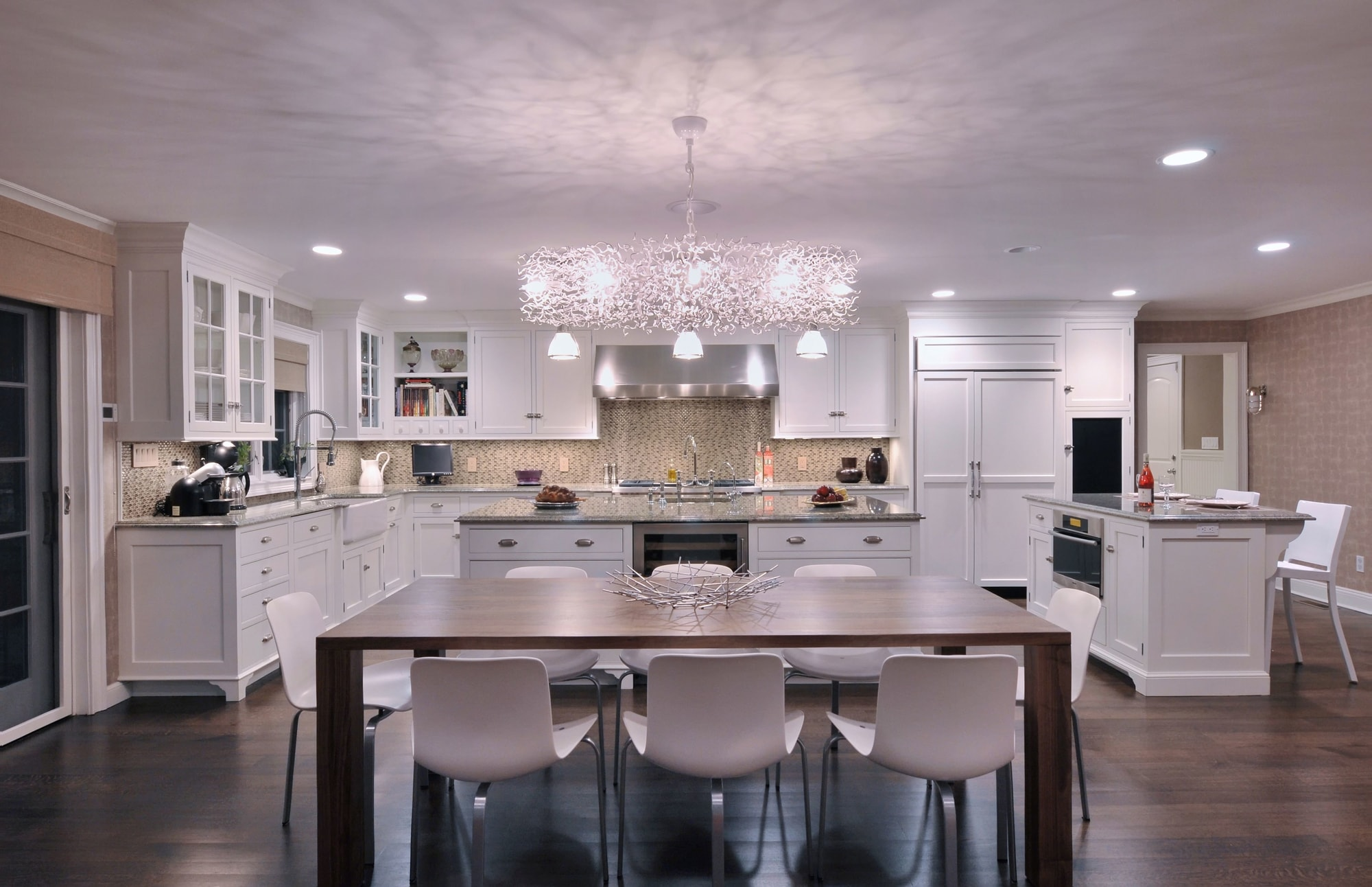 Transitional style kitchen with an open plan kitchen design